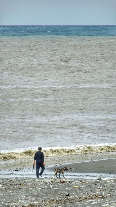 Taiwan Taidong, Taiwan Sea Man Dog Waves Beachphotography Travel Photography EyeEm Best Shots Eye4photography  Nature Pacific Ocean台湾 台东 大海.狗.男人 海滩 海浪 太平洋 旅行 旅行摄影 享受生活 People Of The Oceans