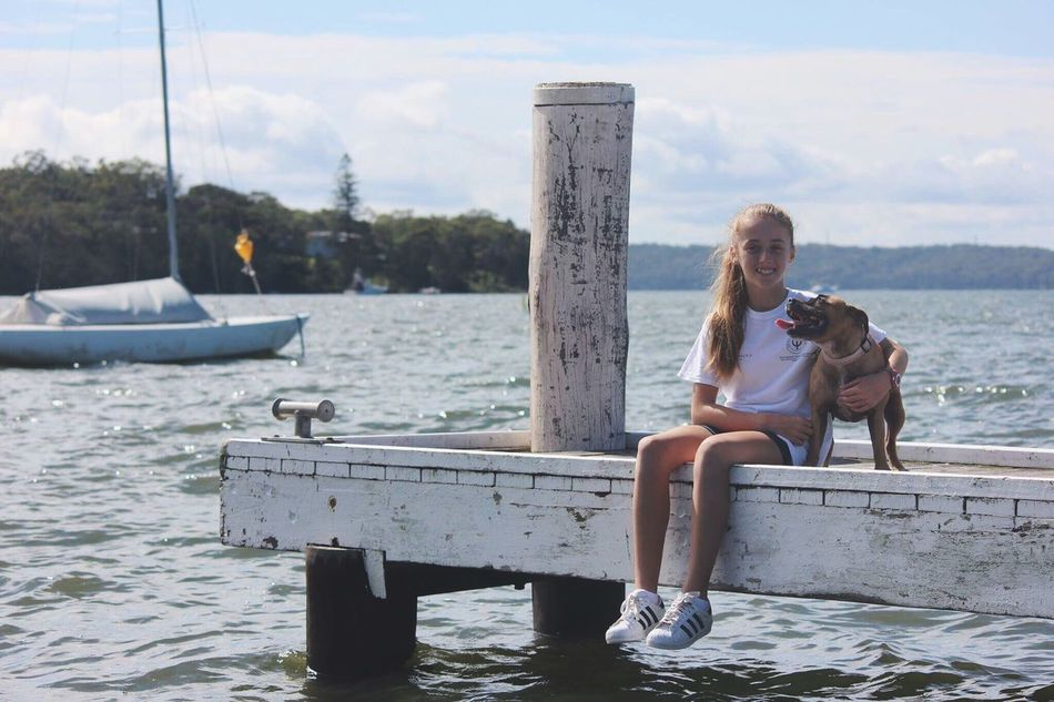 Photo shot was jasmine⛵️ Water Sitting Full Length Day Dog Lake Smiling Pier Outdoors Nature Bonding Happiness Pets