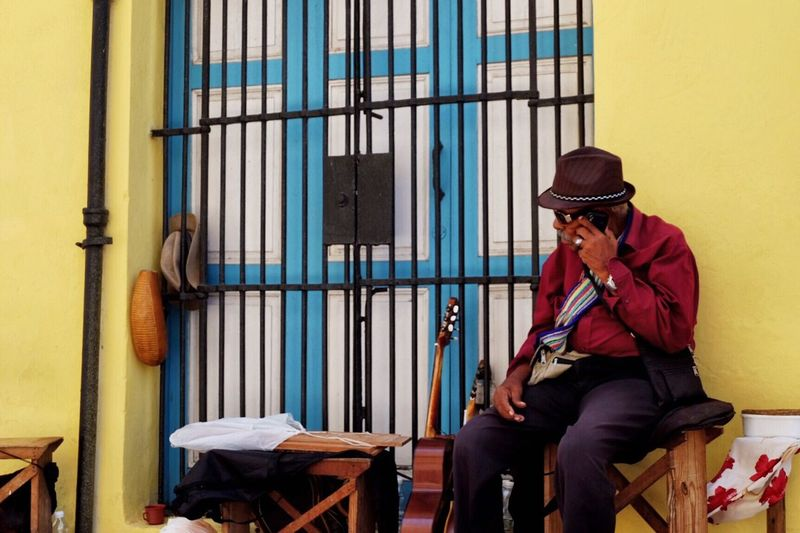 It's always summer in Havanna/Cuba One Person Real People Three Quarter Length Sitting Hat Day Headwear Cap One Man Only Lifestyles Young Adult Full Length Outdoors Only Men Architecture Technology Adult People Adults Only Cuba Havanna, Cuba Live For The Story The Street Photographer - 2017 EyeEm Awards