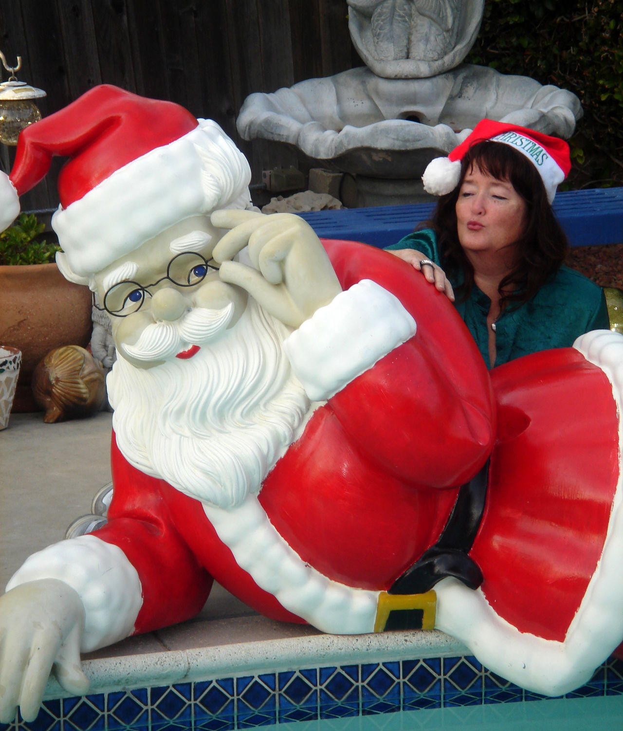Me in a friend's backyard. Backyard Blowing A Kiss Casual Clothing Childhood Cute Day Fun Glasses Leisure Activity Pool-side Santa Lifestyles Outdoors Portrait Red Red Relaxation Santa By The Pool Santa Hat Sitting Smiling Warm Clothing White