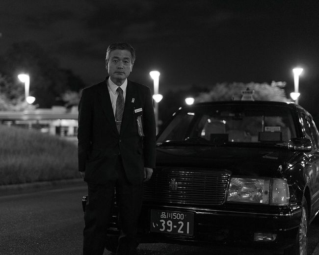 Taxi Driver One Man Only Night One Person Black And White Standing Looking At Camera Outdoors People People Watching Sigmalens Sigma Canon6d Canon Dark Monochrome Photography Tokyo Japan Photography Followme Taxi Driver Taxi Japan Person Car Instagood