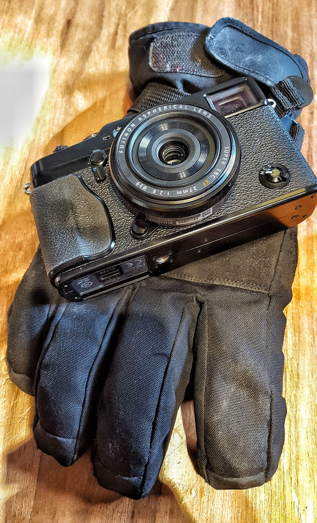 Tools of the trade Arrangement Black Camera Camera Lens Close-up Collection Directly Above Glove Indoors  Metal And Fabric Mirrorless Camera No People Photography Themes Retro Camera Side By Side Textures And Surfaces Winter Glove Wooden Texture