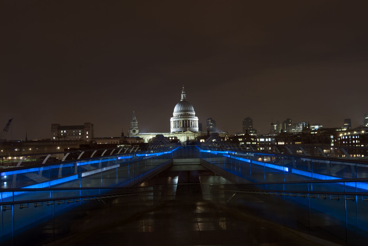 Illuminated Millennium Bridge With St Paul Cathedral In Background At Night