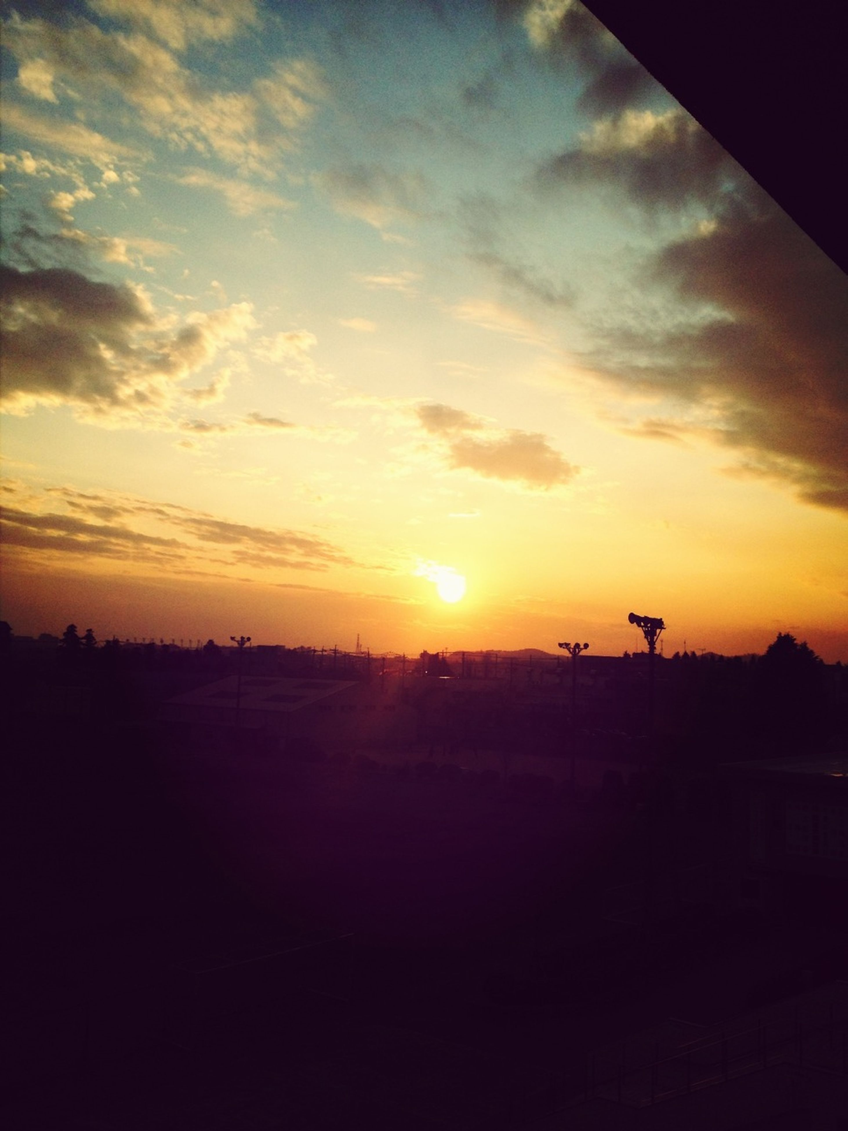 sunset, silhouette, sky, orange color, landscape, scenics, cloud - sky, beauty in nature, tranquil scene, tranquility, nature, sun, cloud, idyllic, field, sunlight, dark, dramatic sky, outdoors, no people