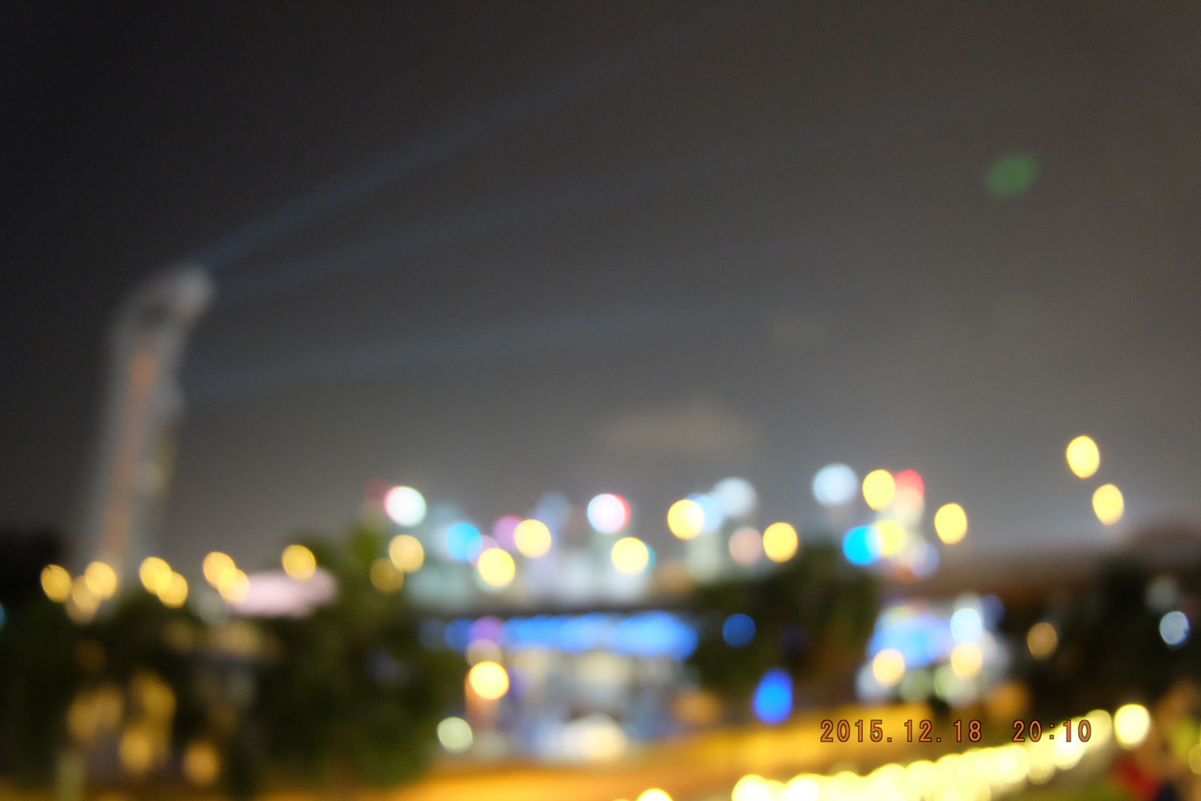 illuminated, night, defocused, lighting equipment, city, light - natural phenomenon, multi colored, building exterior, glowing, architecture, lens flare, no people, built structure, light, outdoors, selective focus, street, transportation, street light, city life