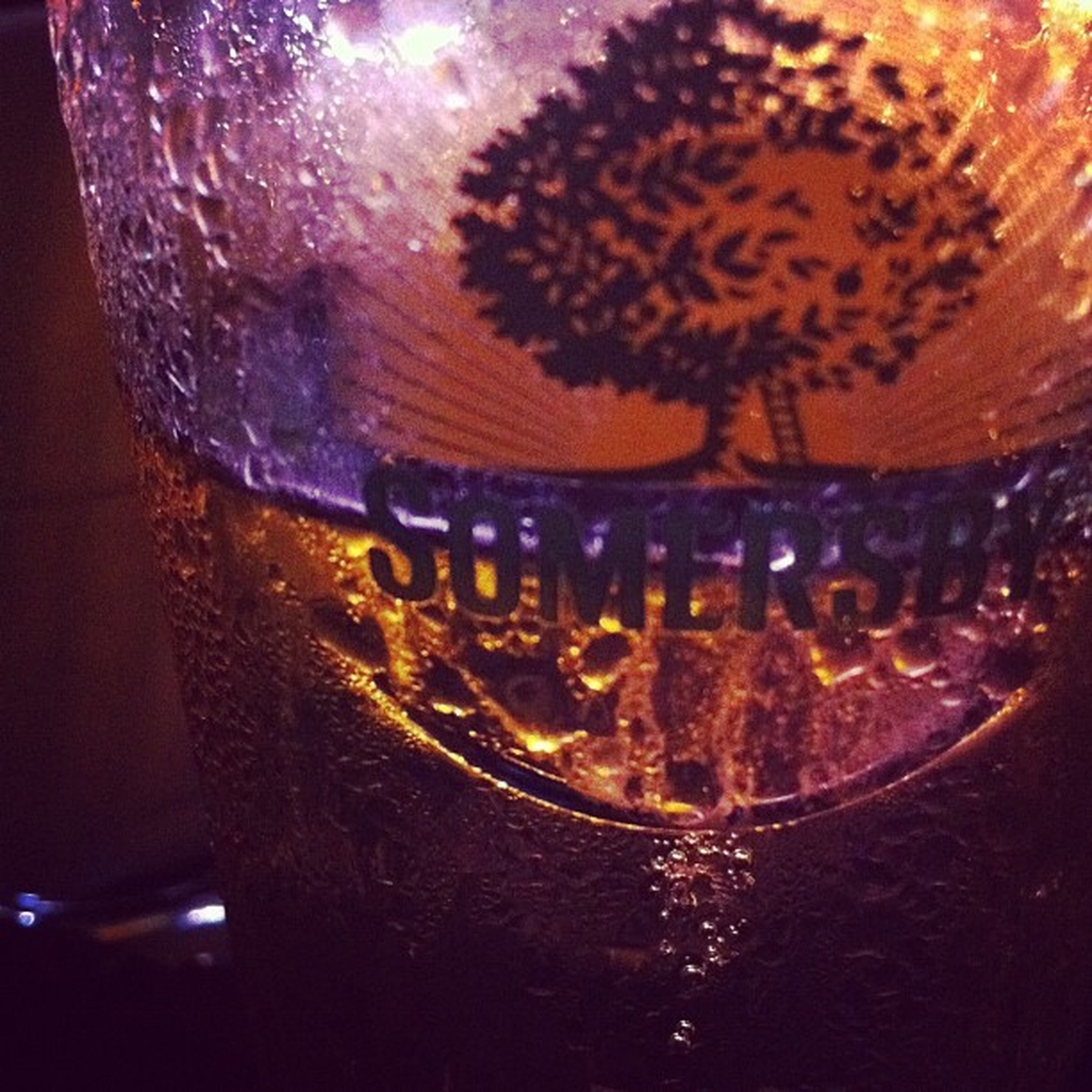 indoors, close-up, glass - material, illuminated, transparent, focus on foreground, celebration, drink, decoration, table, drinking glass, no people, night, freshness, selective focus, lighting equipment, refreshment, glass, reflection, water