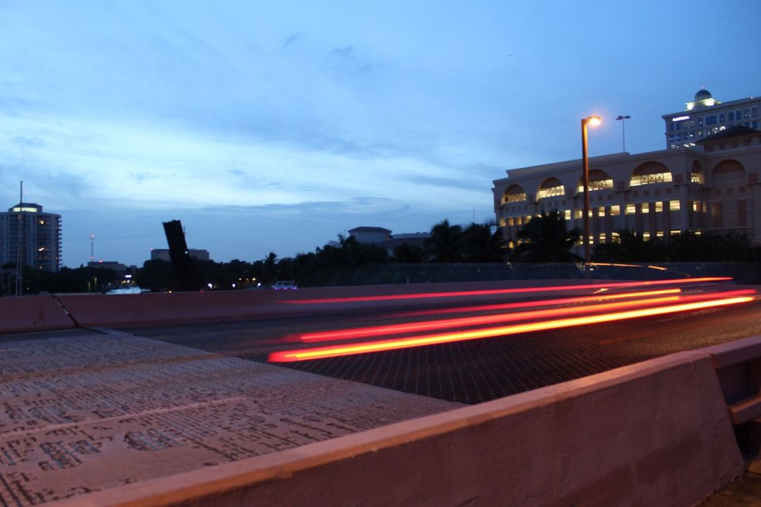 Building Exterior Built Structure Architecture Illuminated Light Trail City Long Exposure Speed Motion Dusk Night City Life Blurred Motion Sky Outdoors Cloud Blue Tail Light Surface Level No People