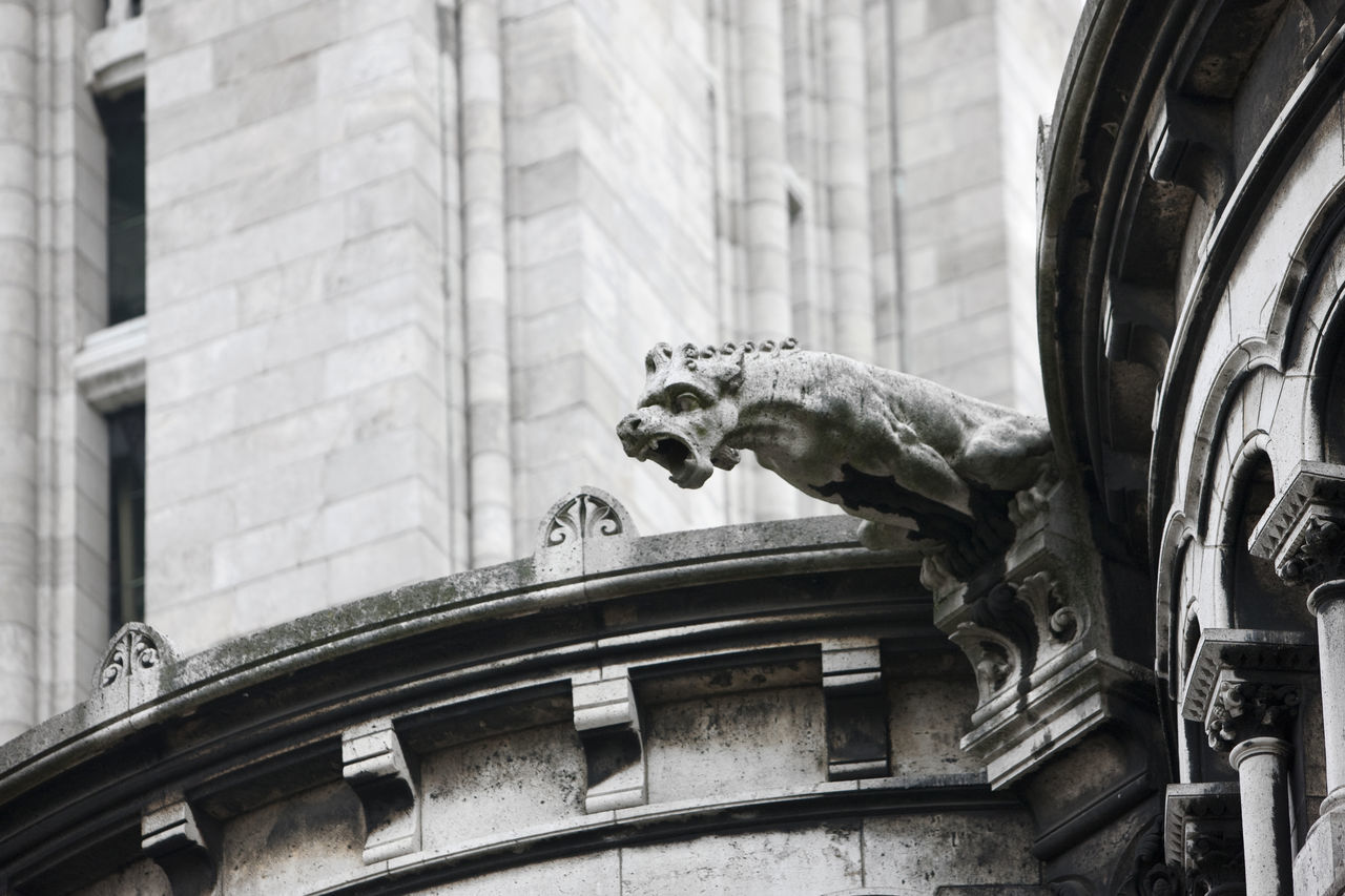 """""""Gargoyle"""" - Basilique du Sacré-Cœur, Paris (A gargoyle is a carved or formed grotesque with a spout designed to convey water from a roof and away from the side of a building) Architecture Building Church Day Gargoyle Montmartre No People Roof Sculpture Statue Stone"""