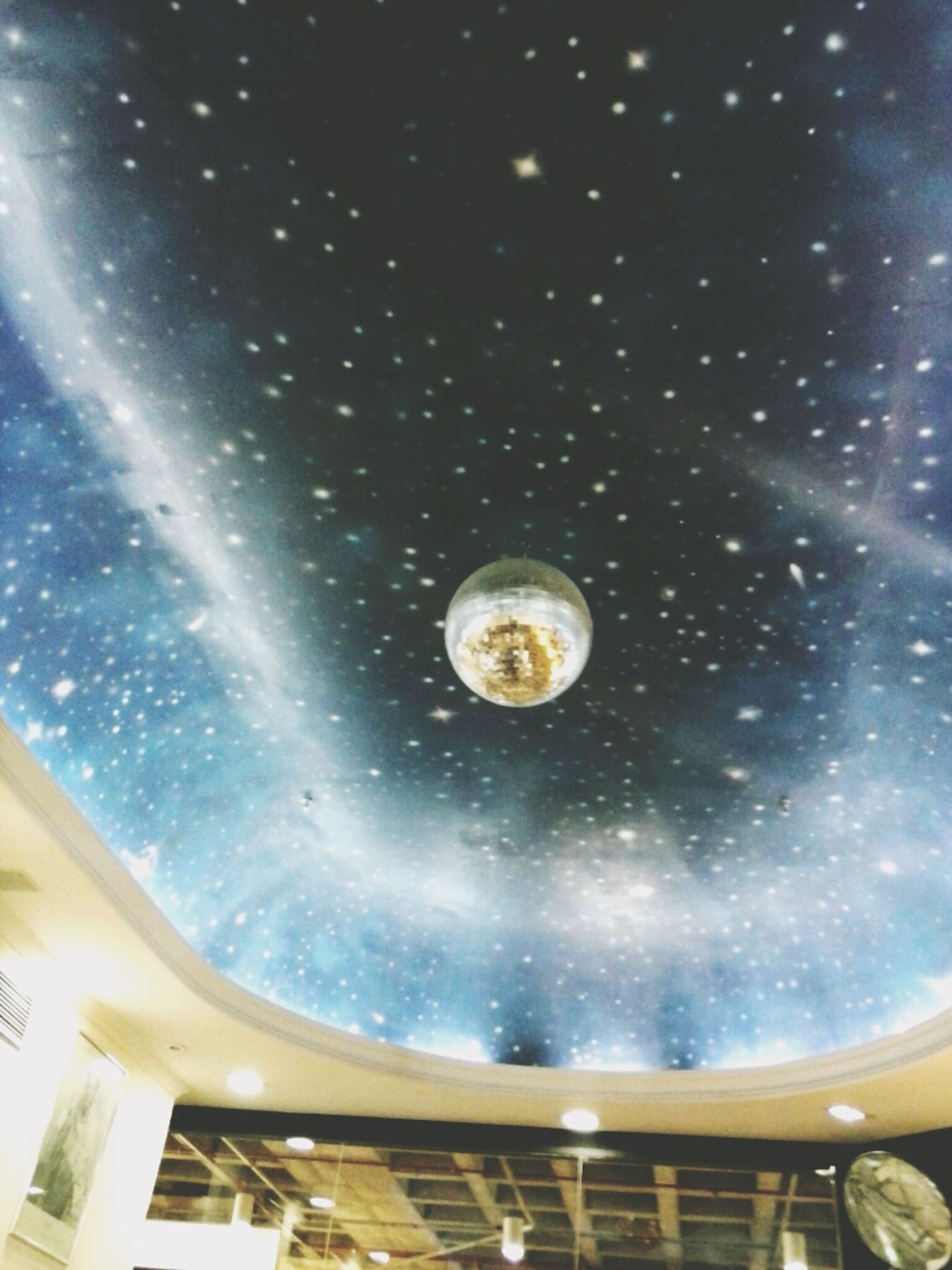 circle, low angle view, part of, night, geometric shape, sky, built structure, airplane, no people, indoors, ceiling, air vehicle, flying, transportation, astronomy, shape, architecture, glass - material, fish-eye lens