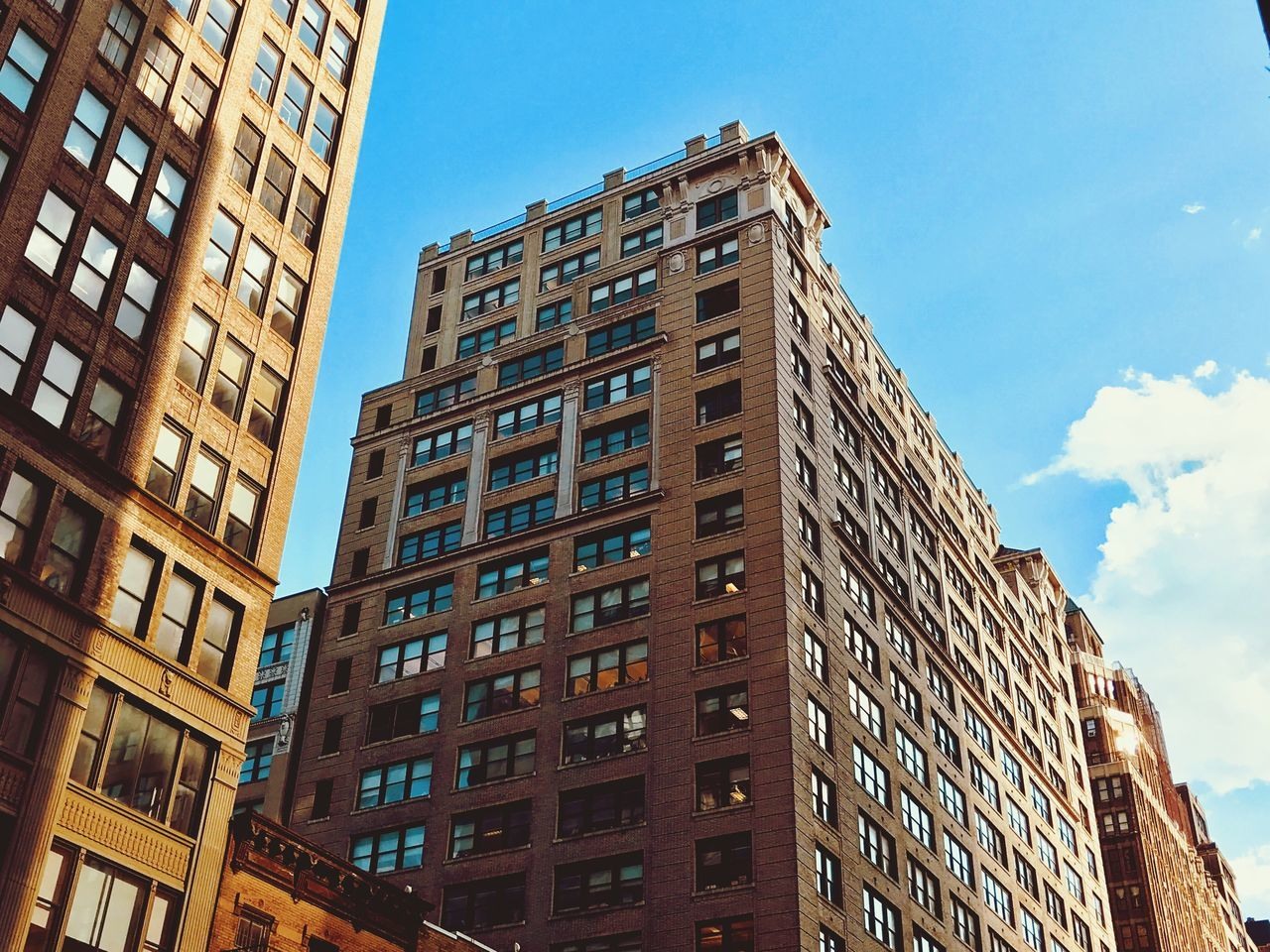 architecture, building exterior, window, low angle view, built structure, day, sky, outdoors, skyscraper, city, no people, modern, apartment