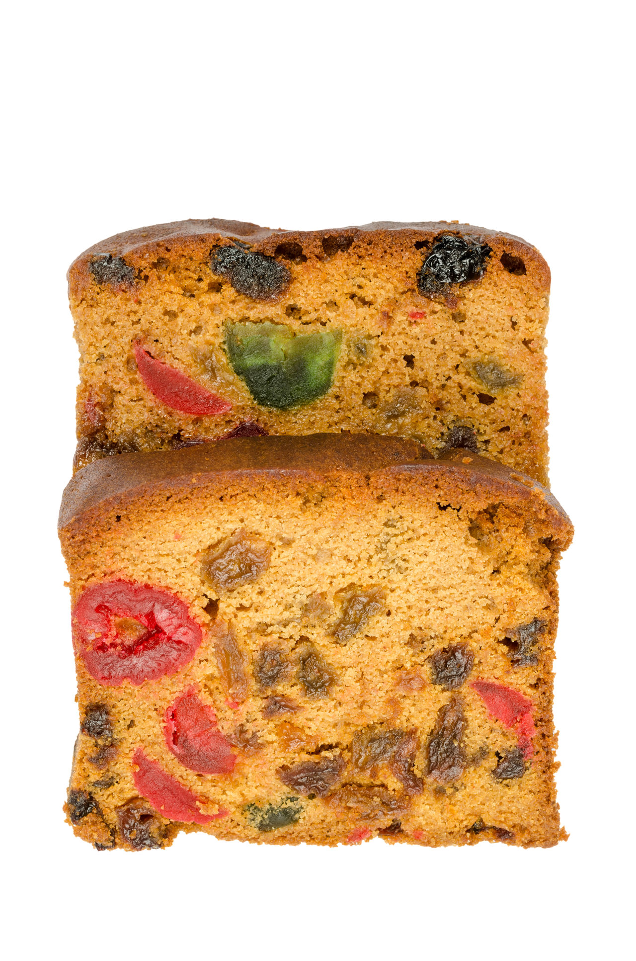 delicious sliced fruit cake with mixed fruit and cherries isolated on white background Baked Brown Color Candied Cherries Cut Delicious Food Dessert Freshness Fruitcake Isolated White Background Mixed No People Nutritious Food Pieces Raisins With Fruit Sliced Square Sugary Sultanas Tasty