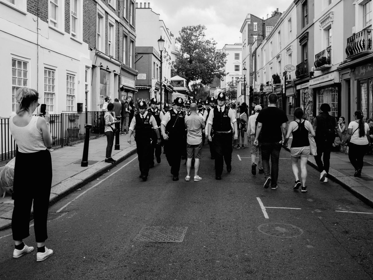 I love British Police, I really love these guys! And this is an example how NOT to take candid shots. Cıty Stranger Street City Life Monochrome Photography Lifestyles Olympus Pen-f London Street Photography Maxgor.com Candid London LifestylesPolice Force Real People Prime Lens 35mm Black And White Photography Black And White People Streetphotography Notting Hill