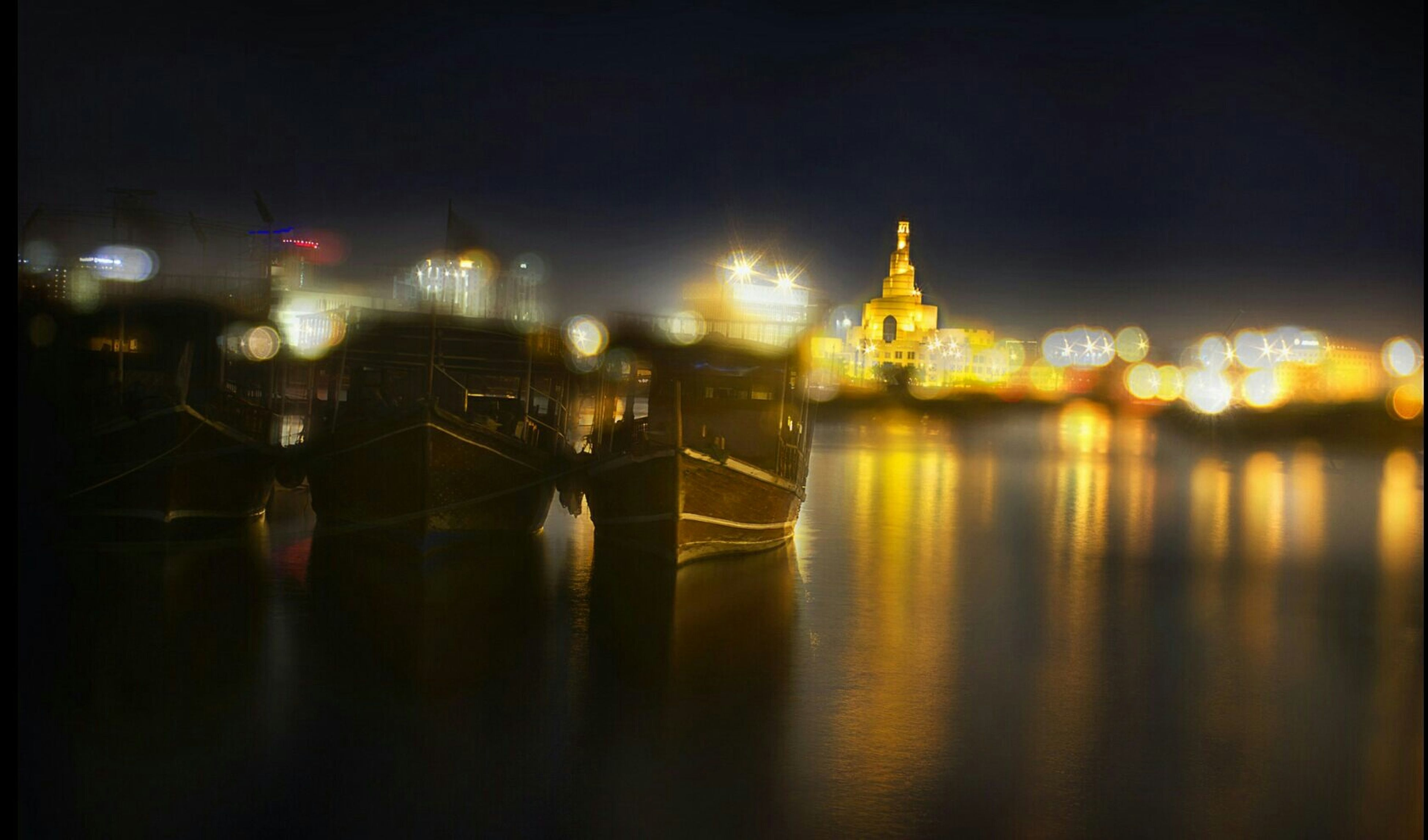 illuminated, night, reflection, built structure, architecture, lighting equipment, water, building exterior, waterfront, light - natural phenomenon, city, no people, river, electric light, sky, street light, light, lit, in a row, dark