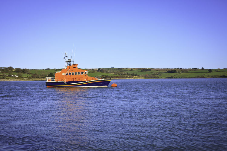 Boat Clear Sky Day Lifeboat Lifeboat RNLI Moored Outdoors River Water Waterfront