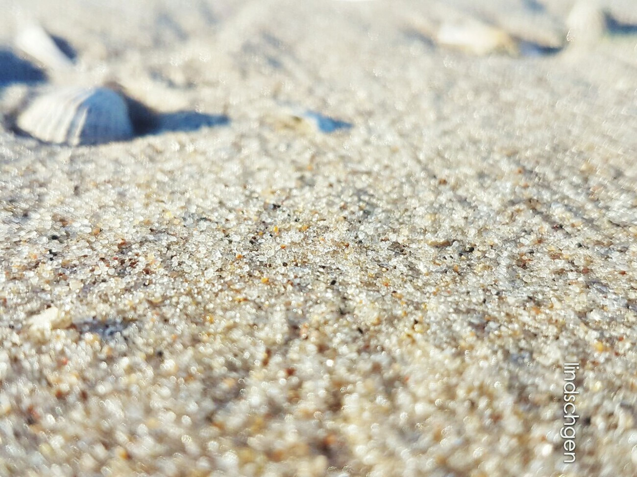 sand, selective focus, surface level, nature, blue, day, outdoors, summer, non-urban scene, tranquility, shore, beauty in nature, full frame, vacations, scenics, tranquil scene, no people