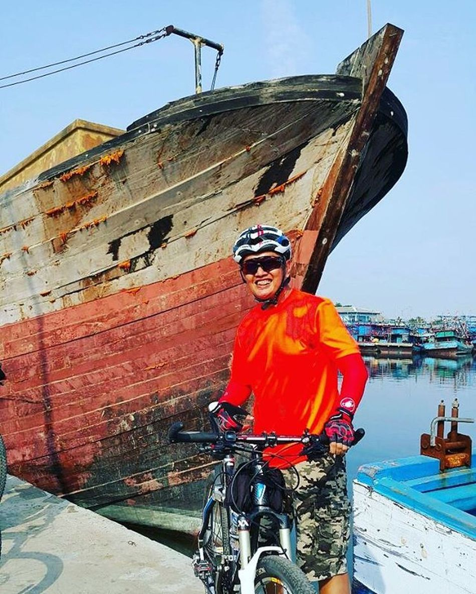 Post in front of a wooden boat at a traditional port Sefo  Nyirebon Nyiremai