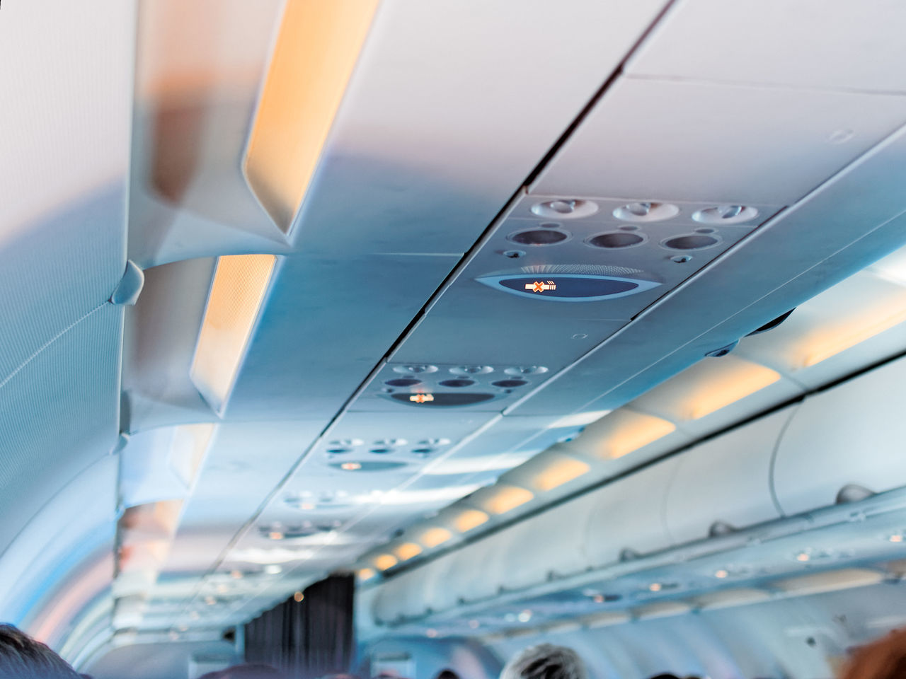 """The sign """"do not smoke"""" in the cabin of the plane in economy class. Smoking ban on flights Aircraft Airplane Cabin Caution Cigarette  Commercial Airplane Control Flight Health Indoors  Instructions Interior Jet Rule Safety Sign Smoking Transport Transportation Warning"""