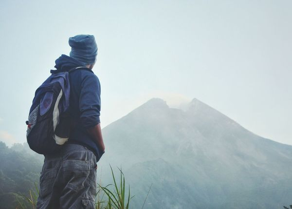 Rear View Mountain Adventure One Person Warm Clothing Travel Destinations One Man Only Outdoors Fog Beauty In Nature Nature Sky Bacpacker Mountain Track Hiking Misty Morning Mount Landscape