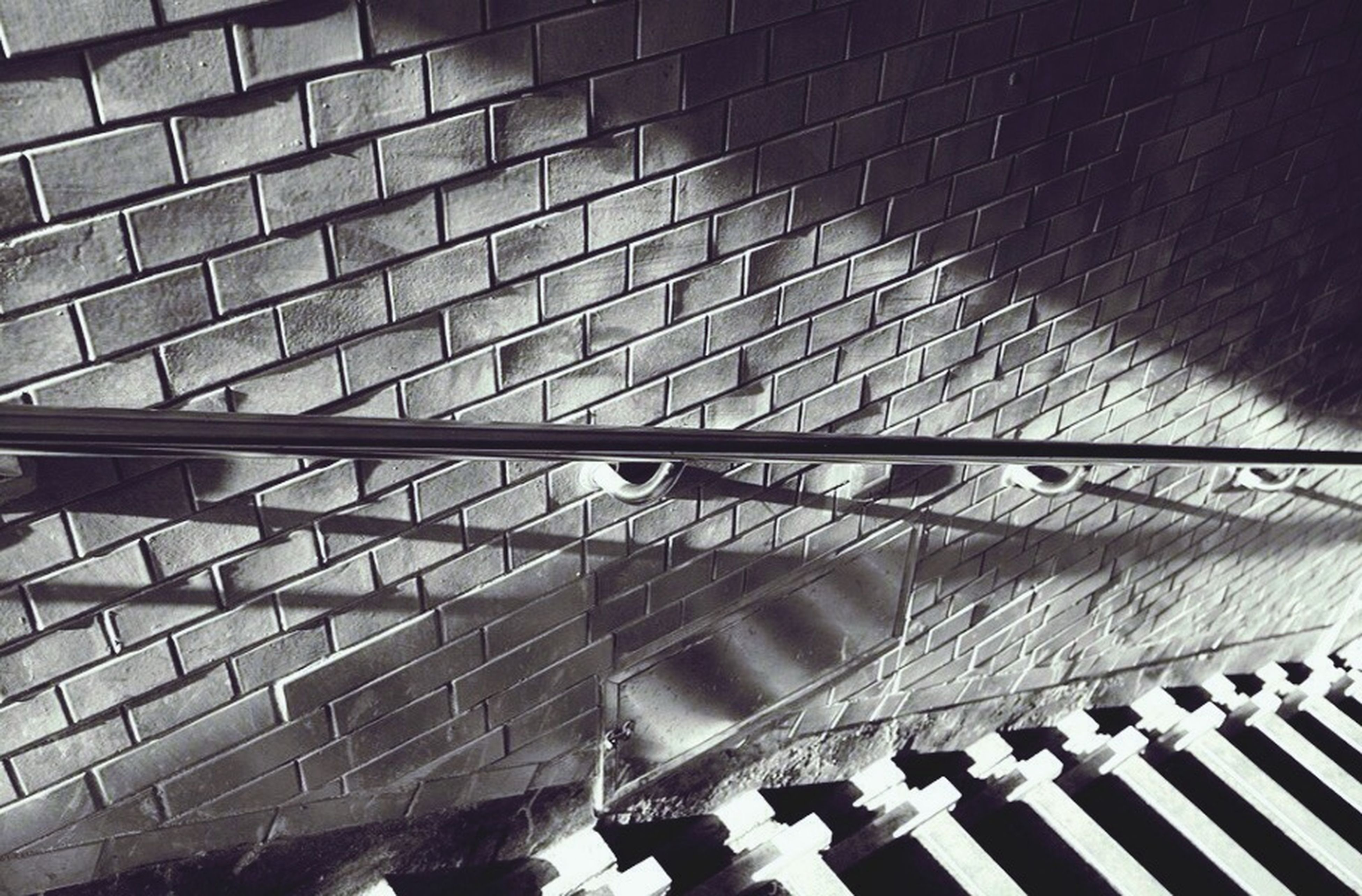 architecture, built structure, pattern, indoors, modern, shadow, reflection, high angle view, building exterior, building, glass - material, ceiling, sunlight, day, repetition, low angle view, design, railing, geometric shape, architectural feature
