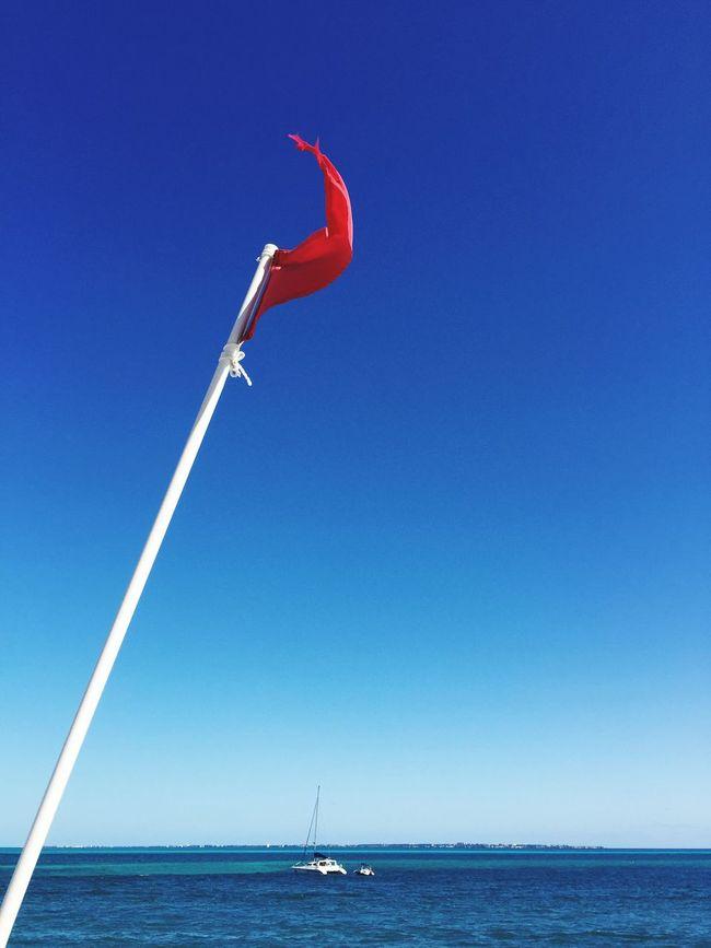 Flag Wind Beach Ocean Boat Sea And Sky Redflag EyeEm EyeEm Germany What A View EyeEm Landscape Eyeem Sea Blue Sky Blue Sea Blue Wave