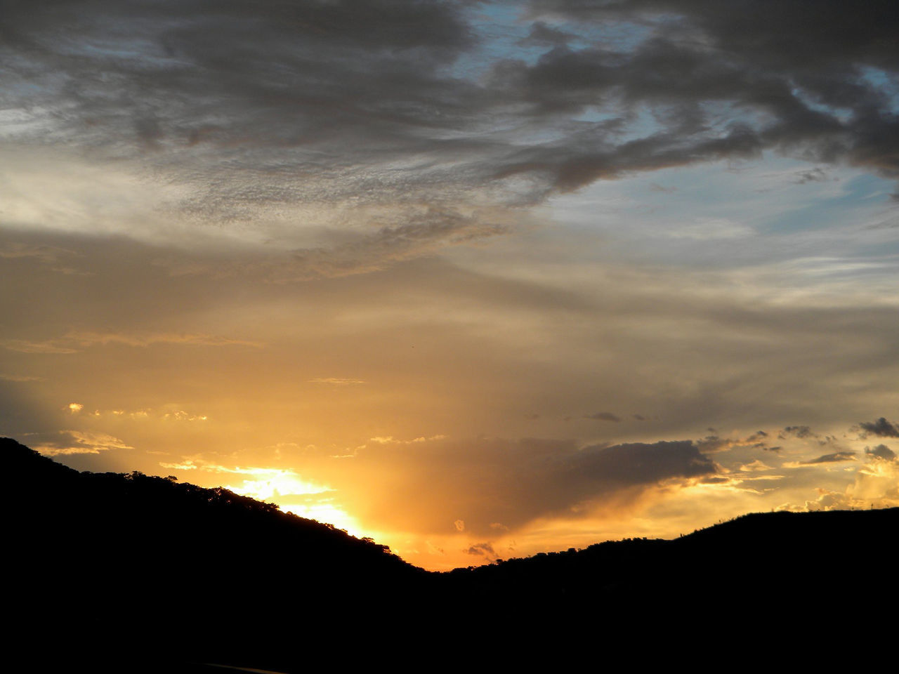 sunset, silhouette, sky, beauty in nature, tranquil scene, nature, scenics, cloud - sky, majestic, tranquility, dramatic sky, no people, outdoors, day