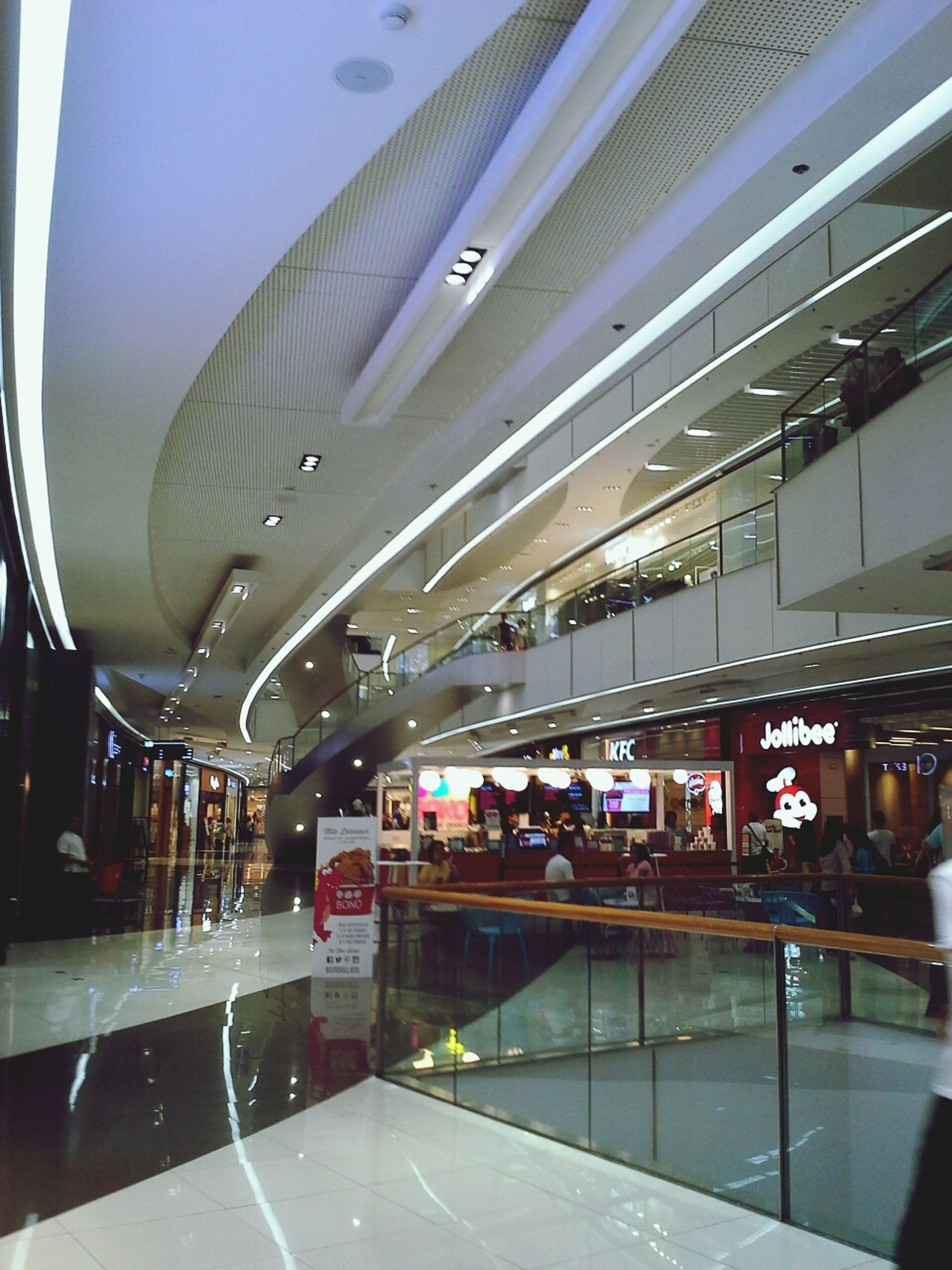 indoors, architecture, ceiling, transportation, built structure, illuminated, railroad station, subway station, modern, public transportation, travel, incidental people, interior, railroad station platform, architectural column, lighting equipment, rail transportation, transportation building - type of building, the way forward, subway