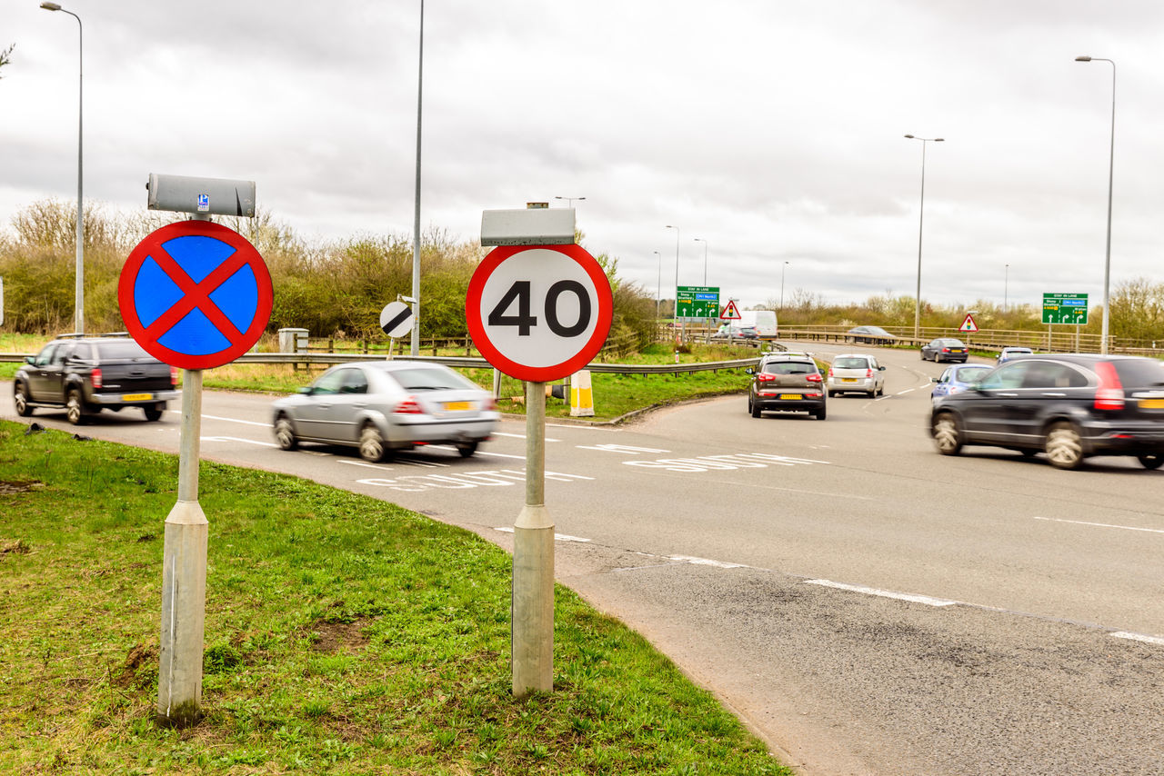 Day view background of UK Motorway Road 40 Speed Limit 40 Cars Communication Day Fourty Guidance Junction Limit M1 Motorway No People Outdoors Road Road Road Sign Roundabout Sky Speed Speed Limit Sign Traffic Transportation Trucks Uk