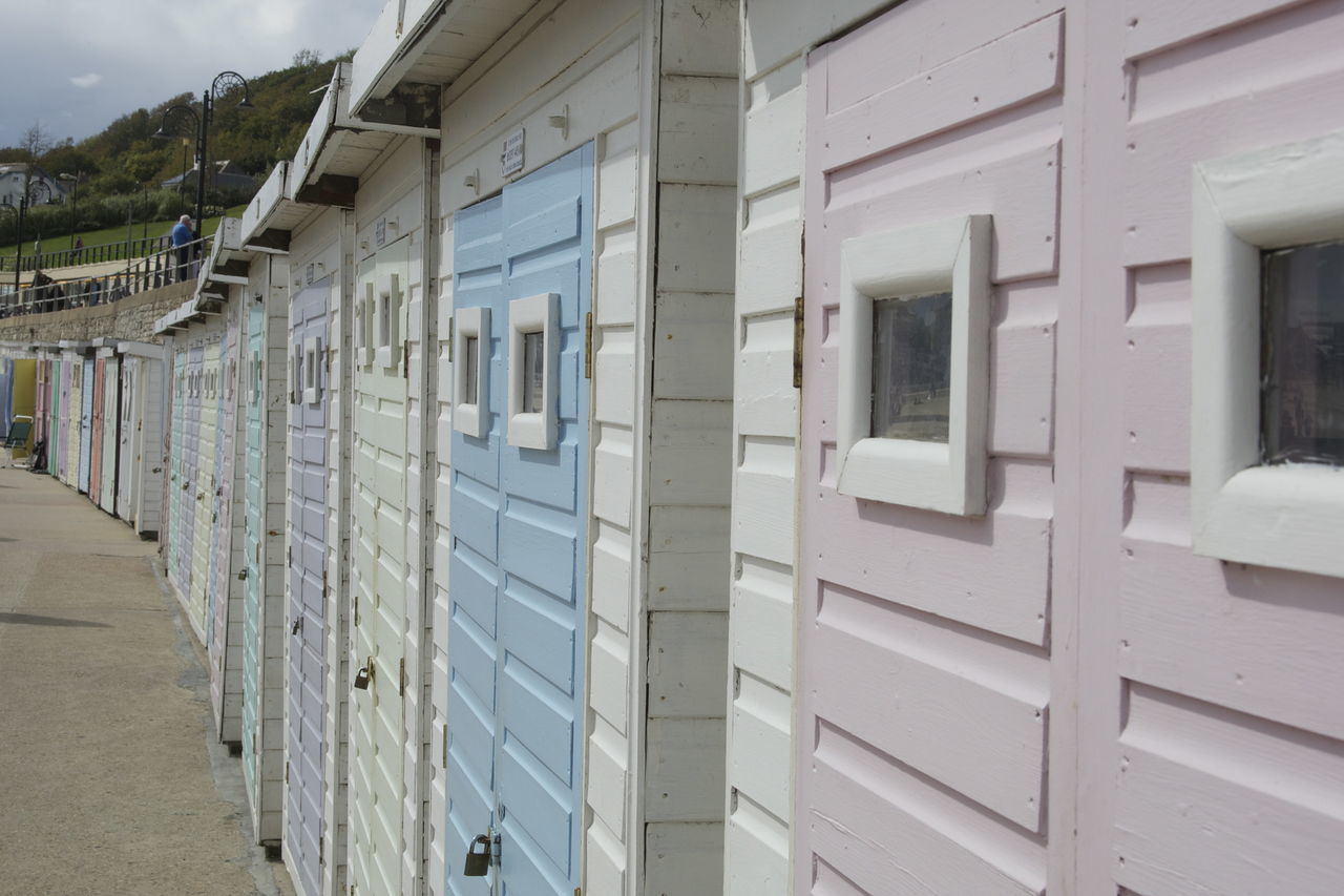 Side view of beach huts in a row