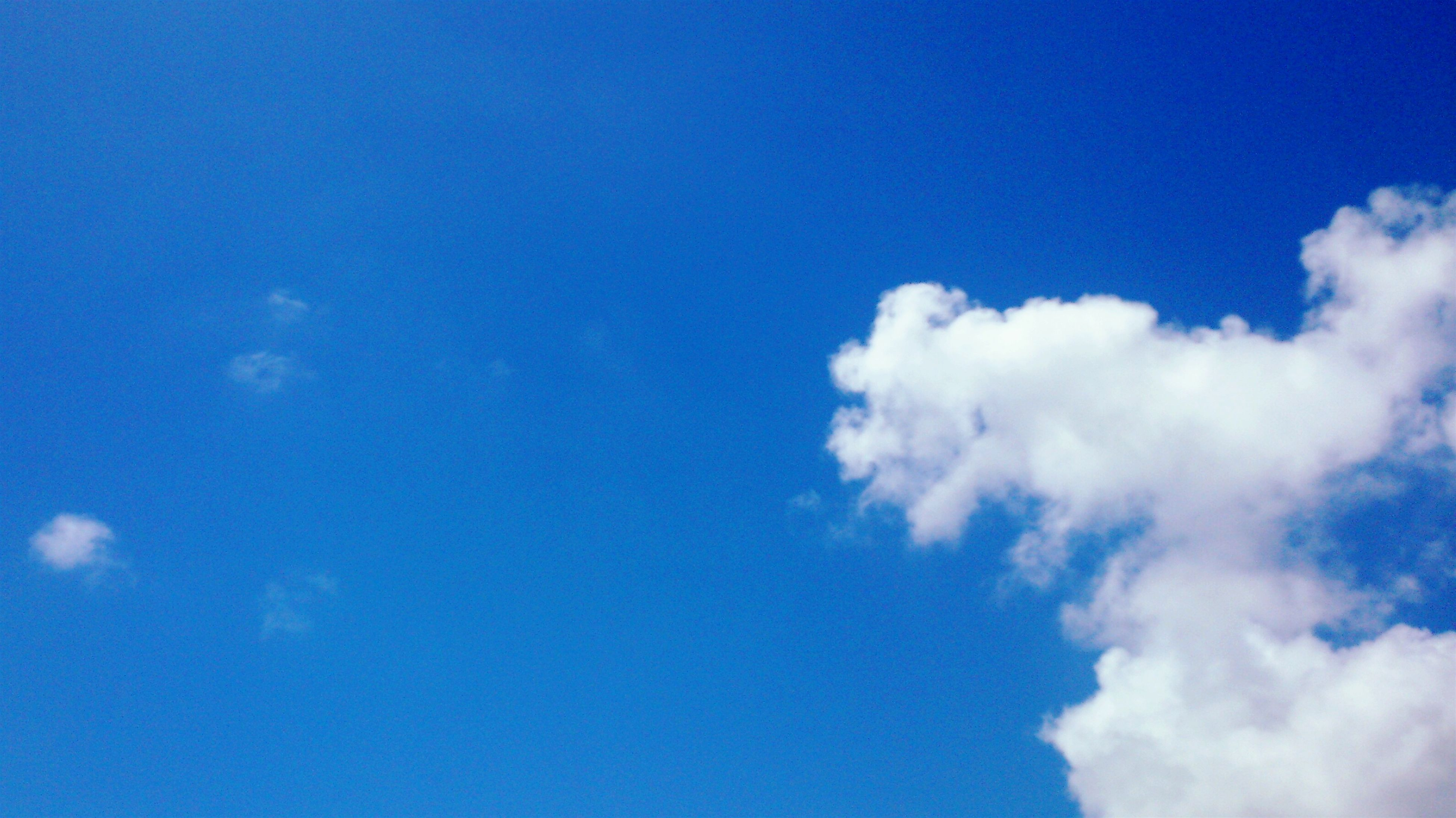 blue, low angle view, sky, beauty in nature, sky only, tranquility, scenics, nature, cloud - sky, copy space, tranquil scene, cloud, white color, day, idyllic, outdoors, backgrounds, cloudscape, no people, majestic