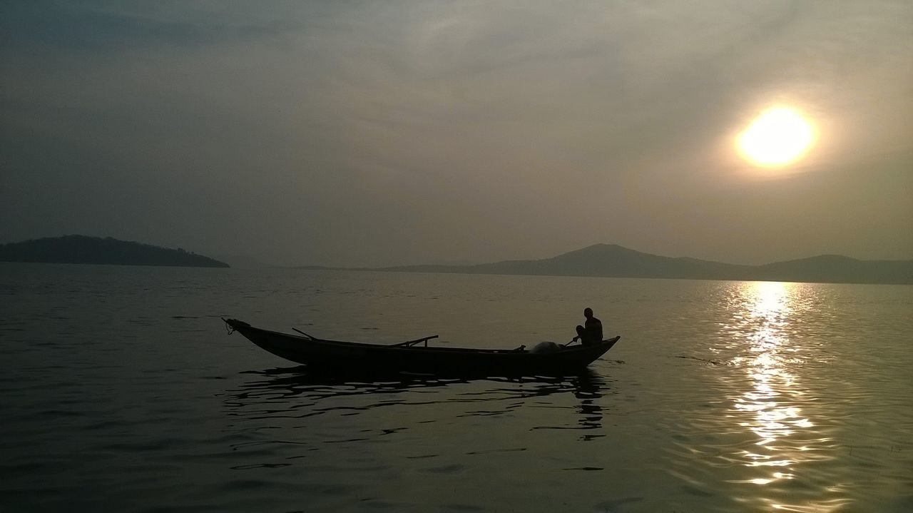 SCENIC VIEW Of Boat On CALM SEA AT SUNSET
