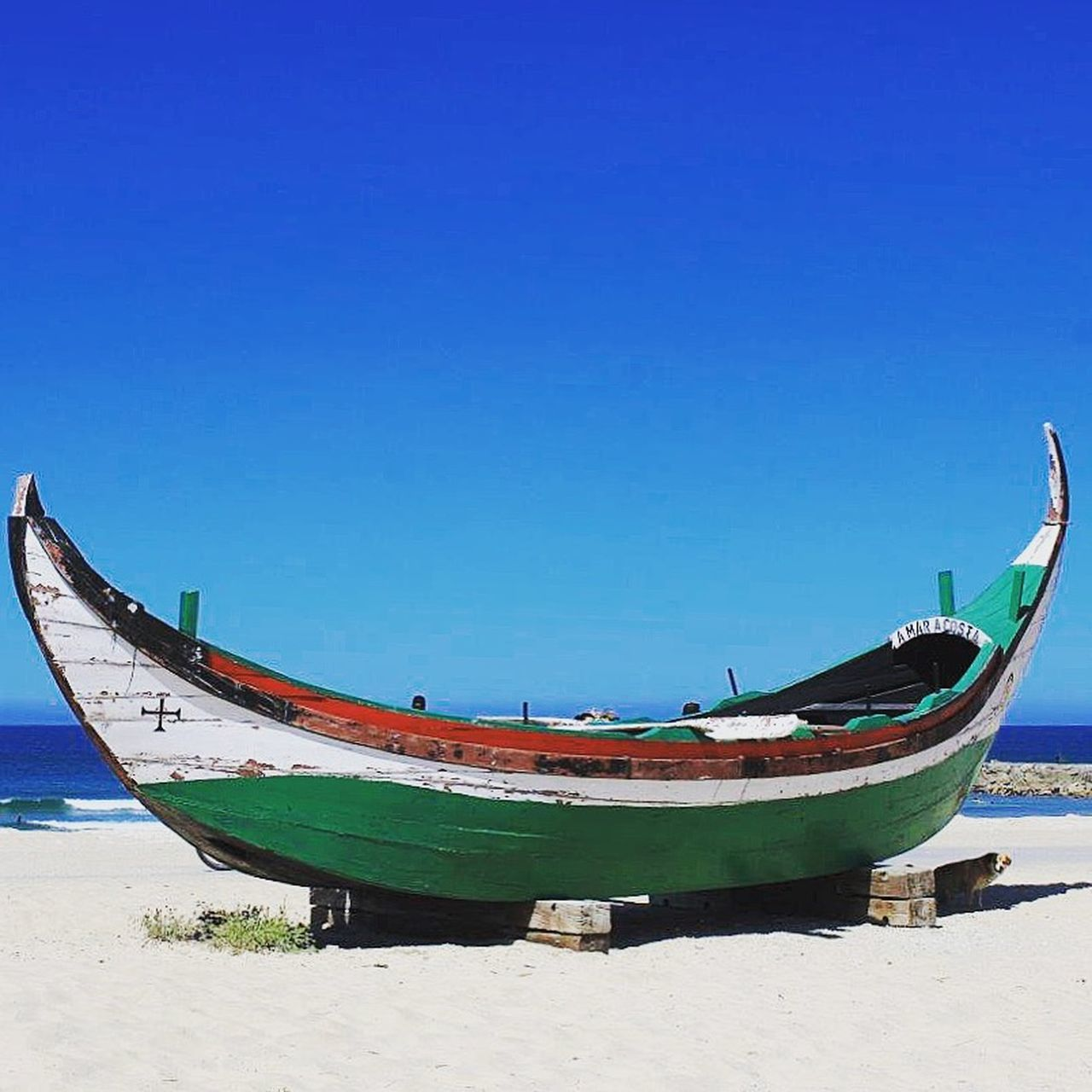 nautical vessel, moored, beach, transportation, sand, sea, mode of transport, water, nature, tranquility, no people, scenics, longtail boat, rowboat, outdoors, day, blue, clear sky, beauty in nature, sky, gondola - traditional boat