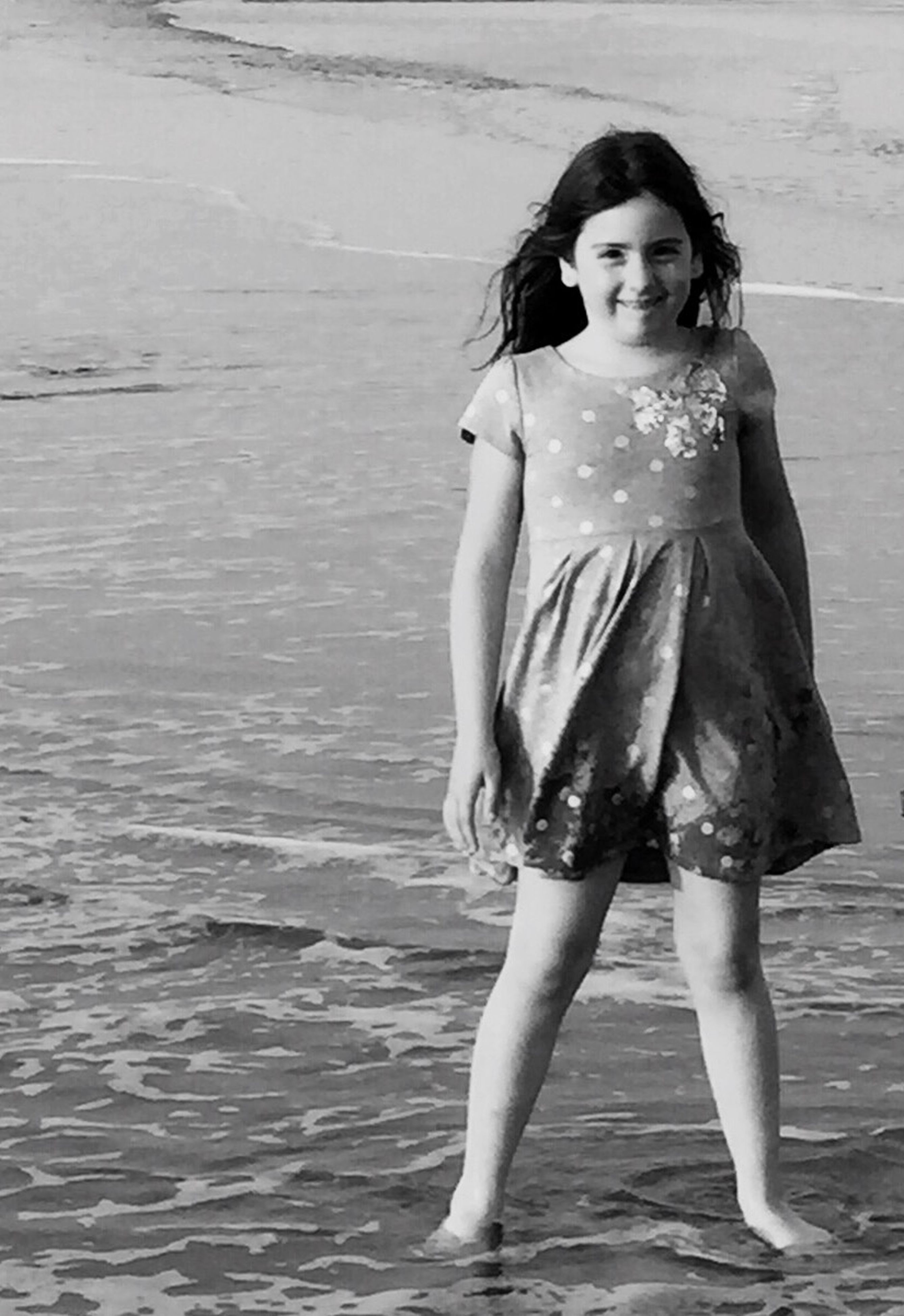 person, childhood, full length, water, lifestyles, leisure activity, elementary age, girls, casual clothing, beach, happiness, innocence, standing, front view, boys, smiling, enjoyment, cute