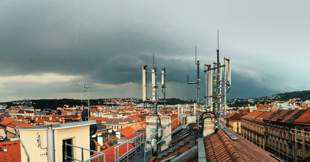 View from the roof Cloudy Praha Prague Roofs Architecture Built Structure Building Exterior Residential District Sky Cloud - Sky Roof No People Antenna - Aerial Cityscape Television Aerial Telecommunications Equipment Tiled Roof  Outdoors