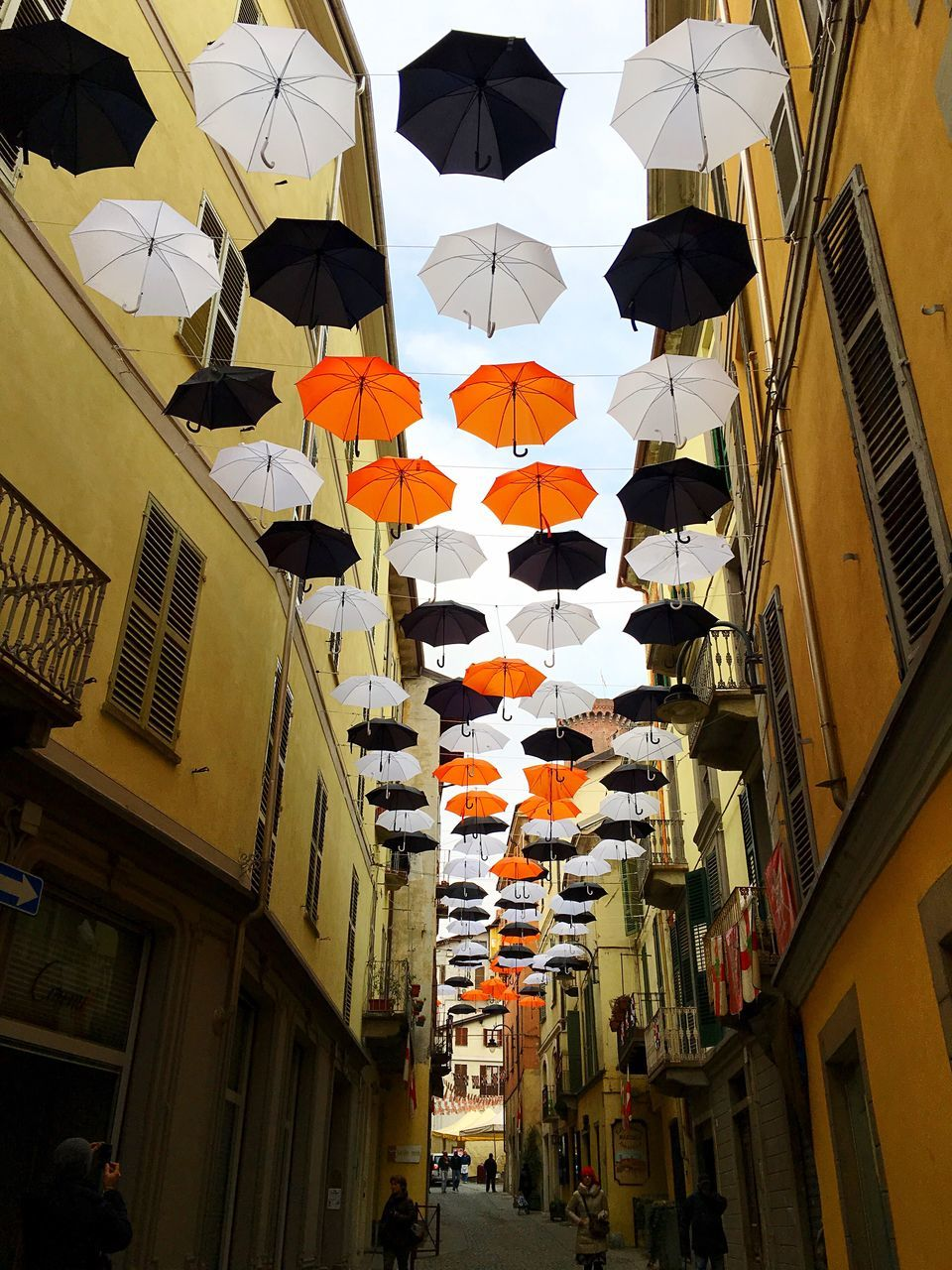 Low Angle View Of Umbrellas Amid Buildings