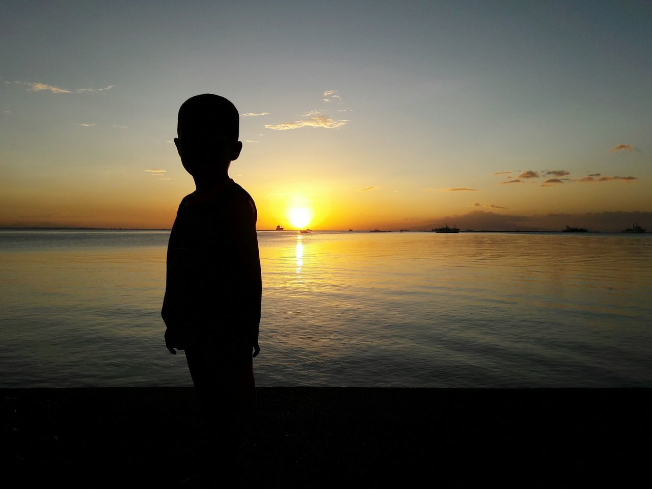 Beginnings of a Little Boy Chance Encounters Street Photography Sunset Beauty In Nature Outdoors Urban Cityscape Little Boy Silhouette Gold Colored One Person Sea Day Eyeem Philippines My Year My View Wander