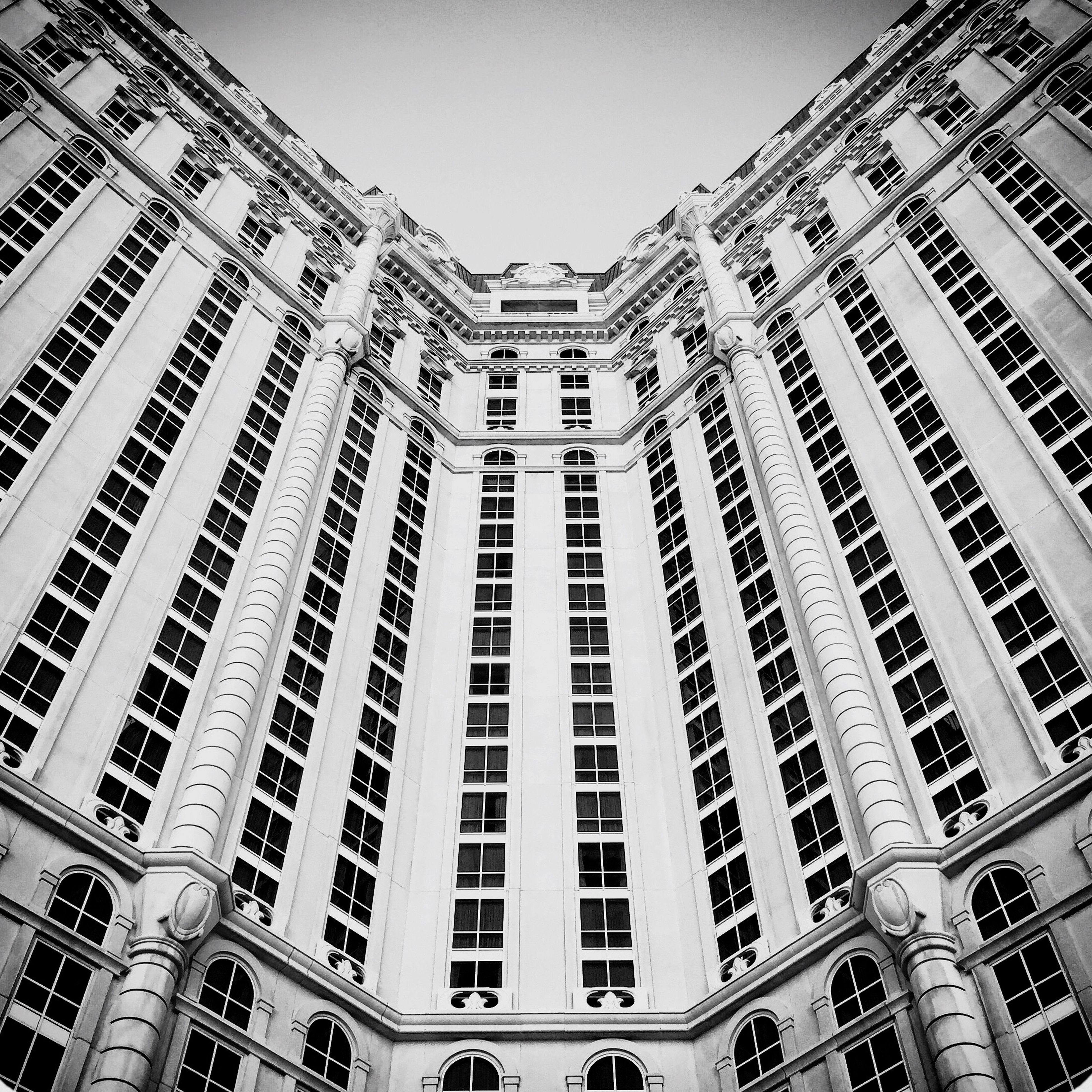 architecture, building exterior, built structure, low angle view, window, city, building, clear sky, residential building, modern, apartment, residential structure, day, sky, outdoors, tall - high, no people, office building, facade, glass - material