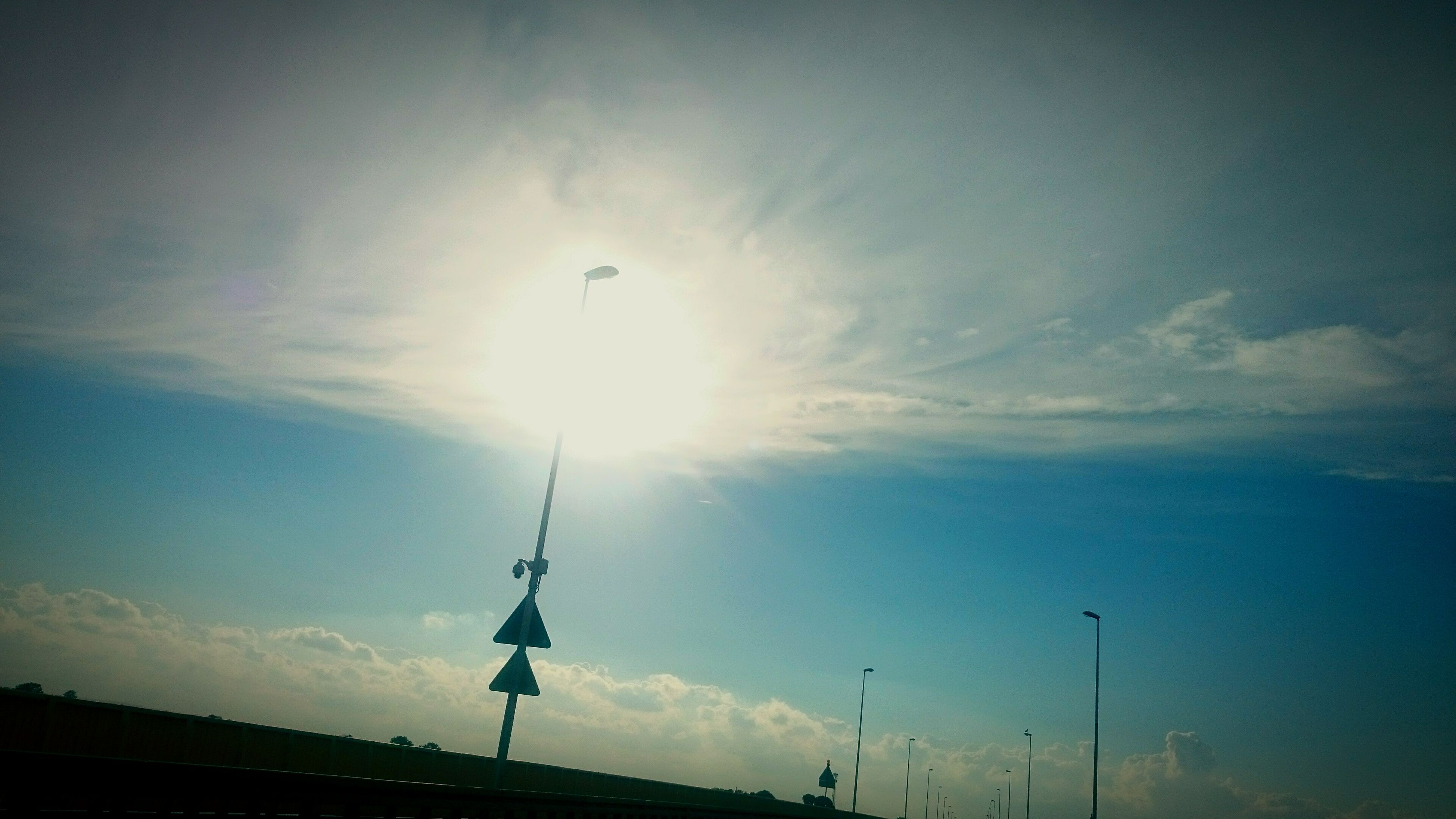sky, silhouette, sun, low angle view, no people, nature, sunset, outdoors, beauty in nature, day