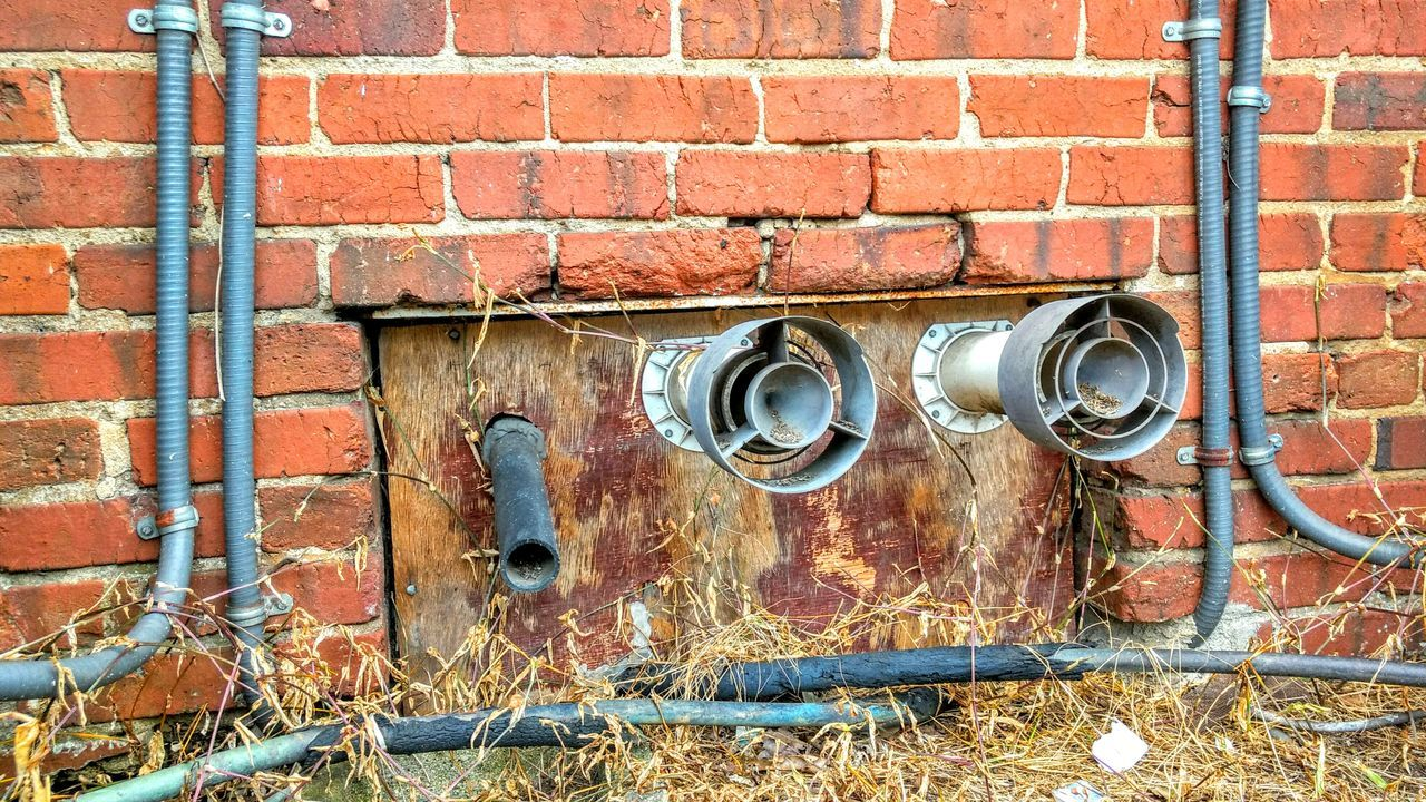 Brick Wall Built Structure Architecture Building Exterior Outdoors Full Frame Day Brick Close-up Full Frame Man Made Object No People Wall - Building Feature Conduit Electrical Outlet Aluminum Urban Power Lines Electricity  Textures And Surfaces Patterns & Textures Fabricated Metal Metalic Structure Weathered