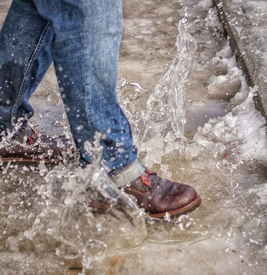 Low Section Human Leg Shoe Human Body Part One Person Day Splashing Water Outdoors Adults Only Close-up Adult People One Man Only Step Into The Water Melting Snow Tough Shoes Timberland Denim Man's Fashion Splash