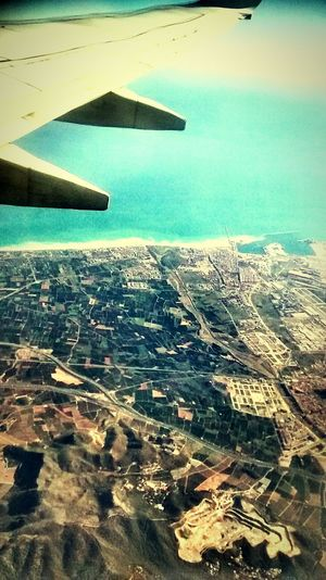 From An Airplane Window Catching A Flight Vacation Time Last-minute Flight Plane Geometric Shapes
