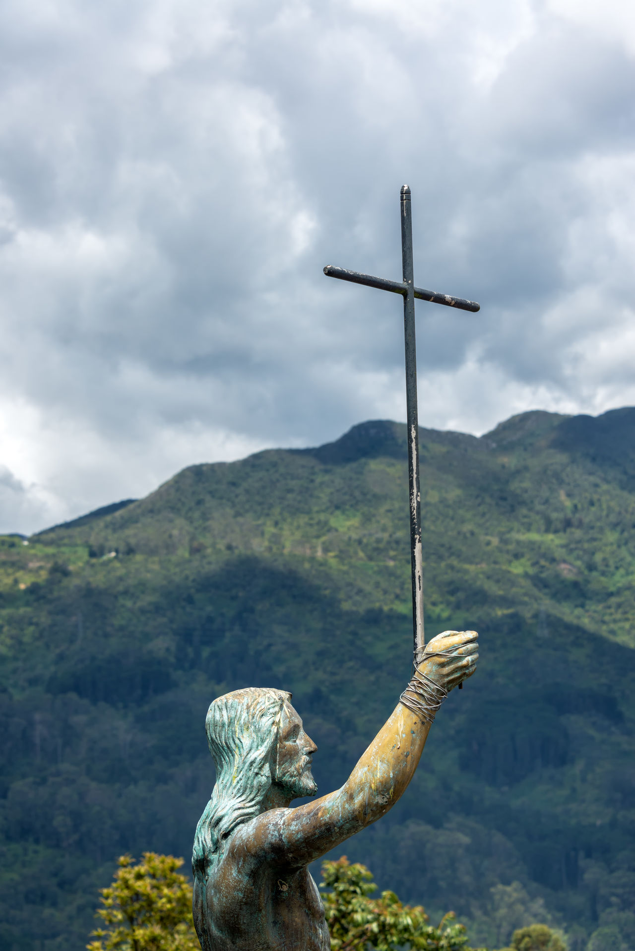 Statue of Jesus on Monserrate Mountain in Bogota, Colombia Bogotá Candelaria Christ City Cloud - Sky Colombia Colombian  Cross Culture Day Downtown Jesus Jesus Christ La Candelaria Mountain Mountain Range Nature Outdoors Sky South America Statue Travel Travel Destinations