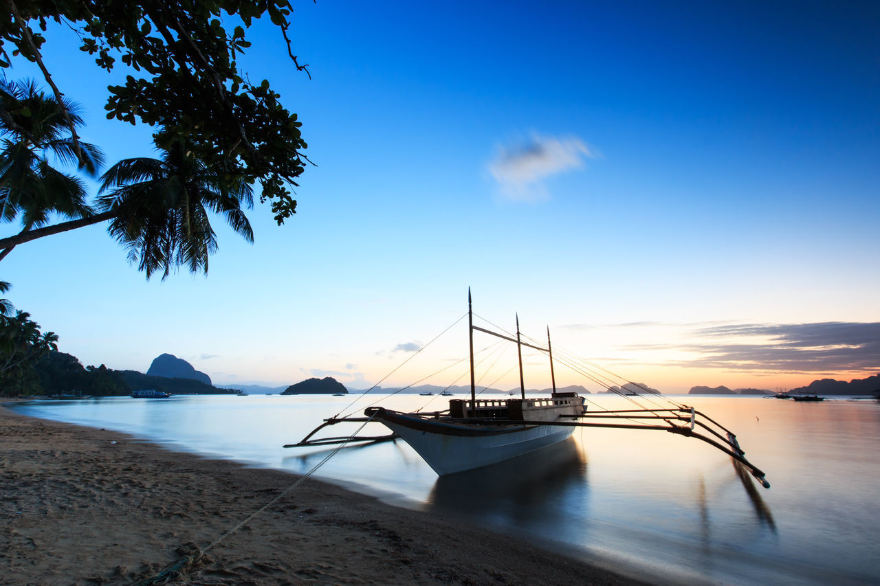 Sunset at Corong Corong beach, Palawan, Philippines ASIA Beach Boat Corong Corong El Nido Nacpan Nautical Vessel Palawan Philippines Puerto Princesa Sand Sandy Beach Sea Sky South East Asia Summer Sunrise Sunset Tranquil Scene Tranquility Tree Tropics Tropics Or Subtropics Underground River Water