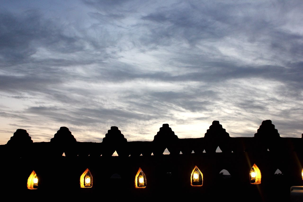 sky, low angle view, cloud - sky, no people, architecture, silhouette, outdoors, built structure, sunset, building exterior, illuminated, day, close-up