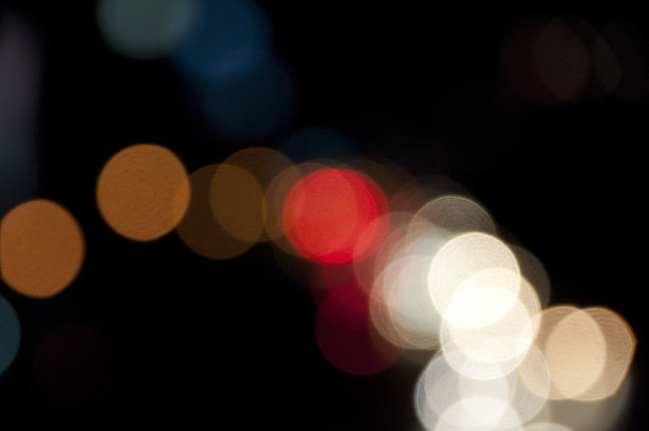 illuminated, defocused, night, lighting equipment, light effect, glowing, circle, no people, christmas, abstract, pattern, celebration, christmas decoration, black background, backgrounds, projection equipment, multi colored, disco lights, close-up, outdoors