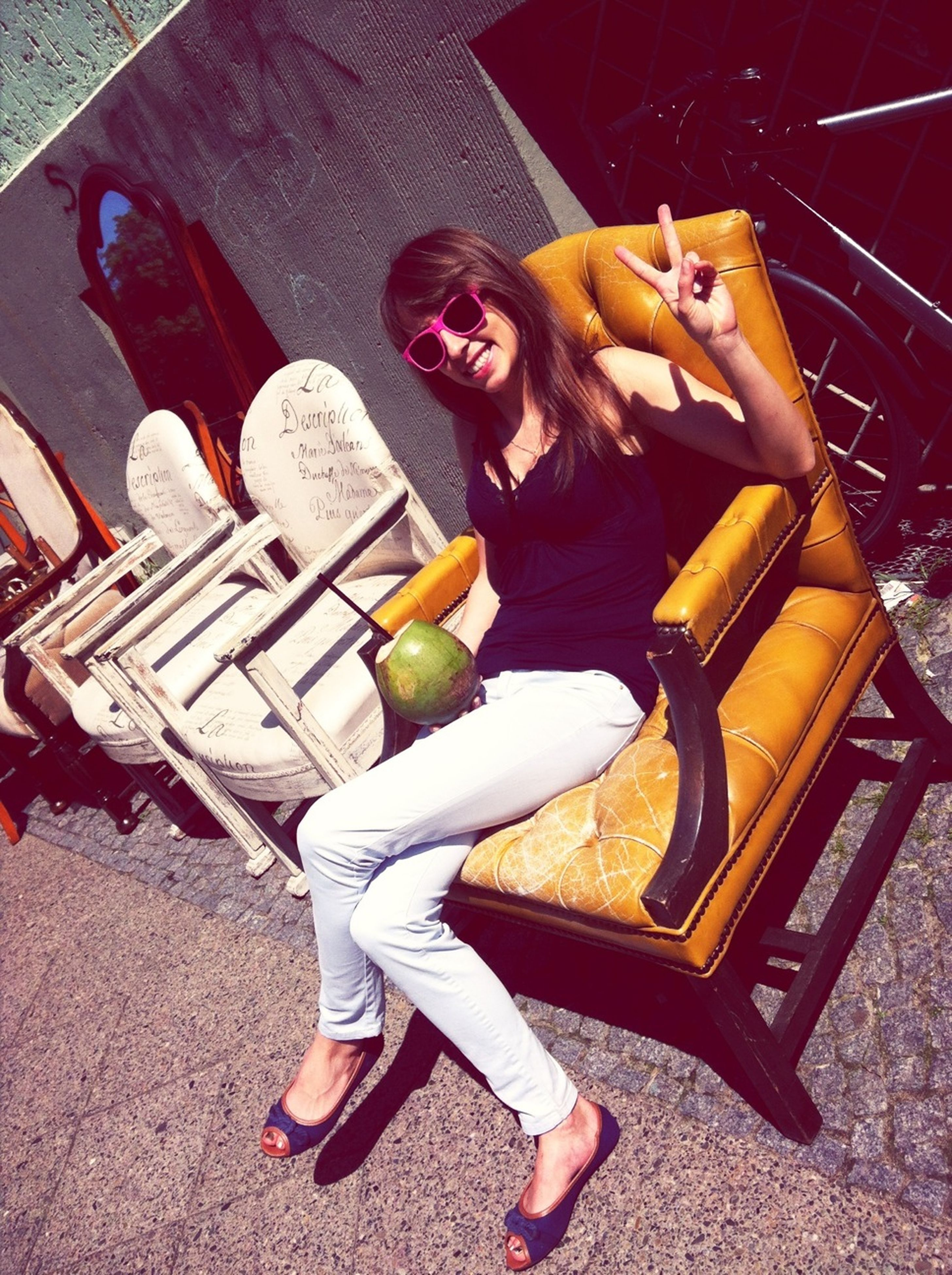 full length, lifestyles, leisure activity, casual clothing, person, childhood, young adult, young women, elementary age, sitting, enjoyment, fun, girls, high angle view, three quarter length, playing, holding, sunlight