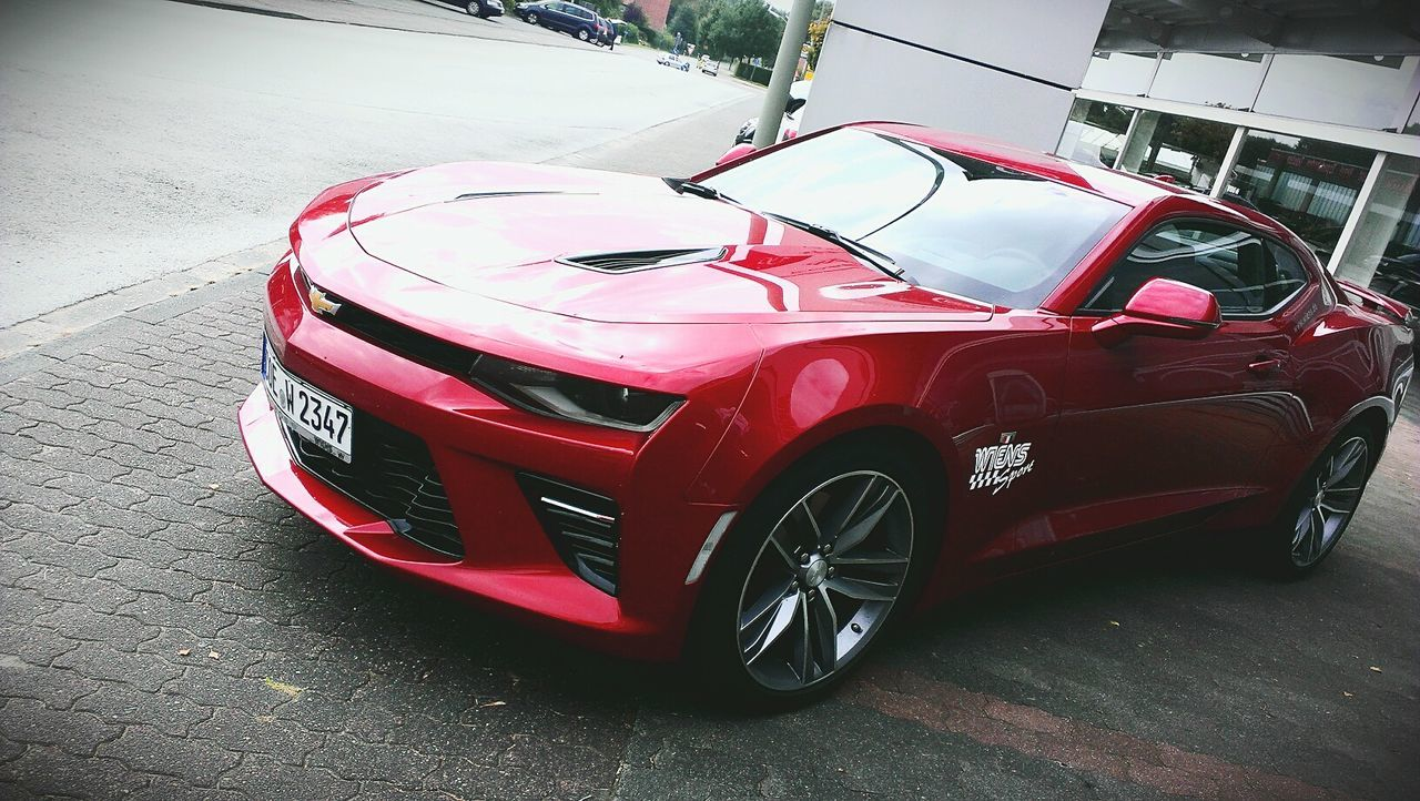 Beast <3 Transportation Mode Of Transport Transportation Mode Of Transport Car Land Vehicle Road Street Travel Red No People Parked Day Stationary Vehicle Hood Outdoors Pink Color Vibrant Color Wiens Autohaus Billerbeck