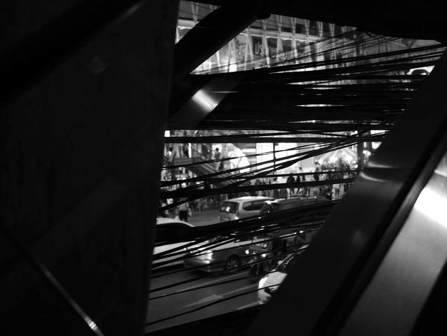 Architecture Blackandwhite Blackandwhite Photography Cable Cables Cars City Life City Life Dark Illuminated Keep Distance Looking Through People Railing Stress