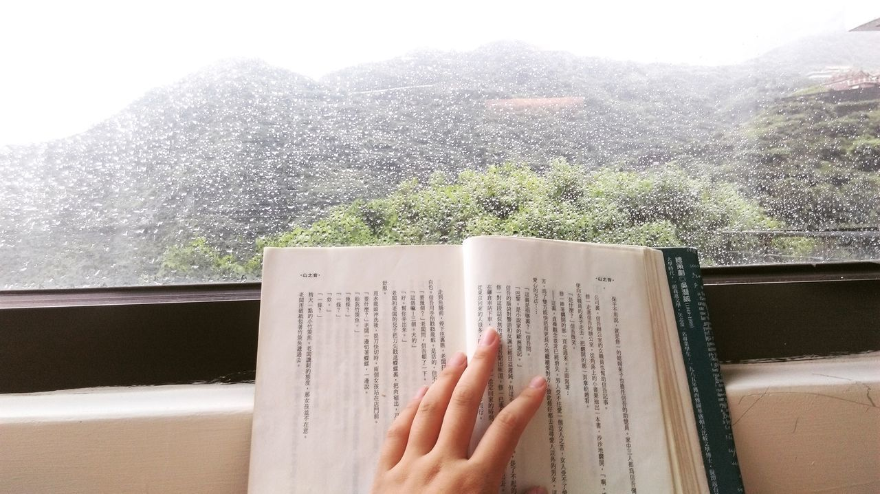 Book Holding Human Finger Mountain View Raindrops Reading Taiwan Window