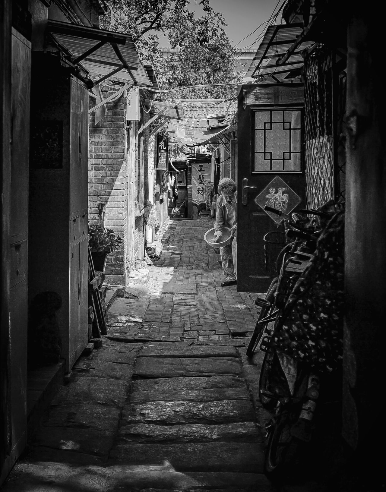 I was shooting a static shot of a Beijing hutong when a little old lady walked into the frame and brought life to the picture. Building Exterior Built Structure Neighborhood Map Neighbourhood Hutong Life Beijing Beijing China Monochrome Blackandwhite Monochrome Photography Monochromatic China Photos Chinese Real China Old China China Beijing Scenes Beijing Trip Hutong Elderly Elderly Woman Old Neighborhoods China Culture 北京 🎈👻