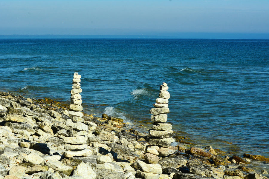 Door County Wisconsin Art Is Everywhere Beach Beach Art Beach Life Beauty In Nature Blue Water Blue Sky Cairn Cairns Clear Sky Creative Creativity Lakeshore Nature Outdoors Rock - Object Rocks Scenics Shore Towers Water